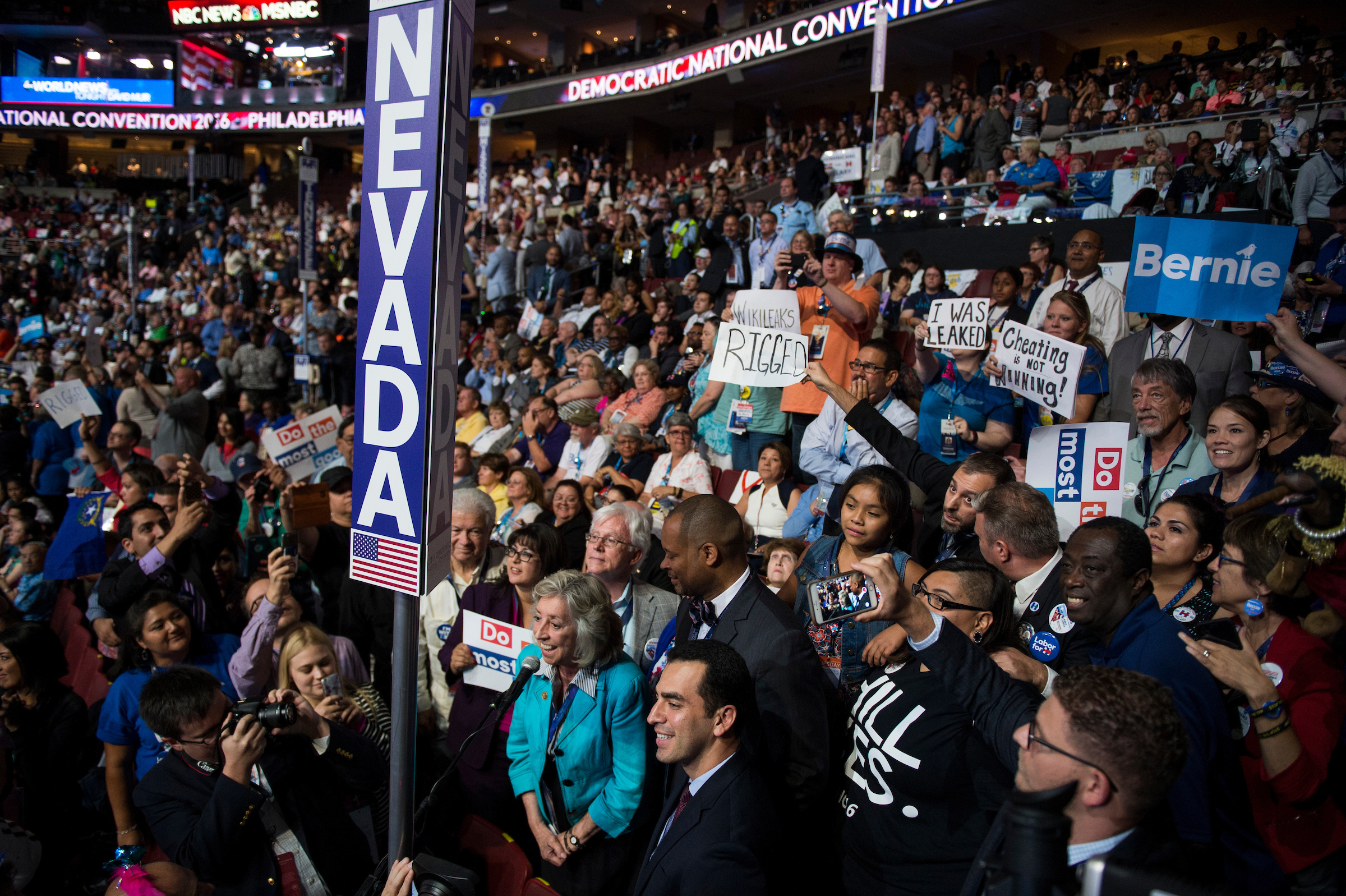 UNITED STATES - JULY 26: Rep. Dina Titus, D-Nev., center, standing next to Congressional candidate Ruben Kihuen, speaks for the Nevada delegation during the roll call vote for the nomination for President at the Democratic National Convention in Philadelphia on Tuesday, July 26, 2016. (Photo By Bill Clark/CQ Roll Call)