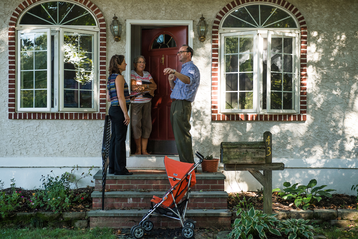 Dan Muroff, right, talks with voter while canvasing a neighborhood in Springfield, Pa. (Tom Williams/CQ Roll Call)