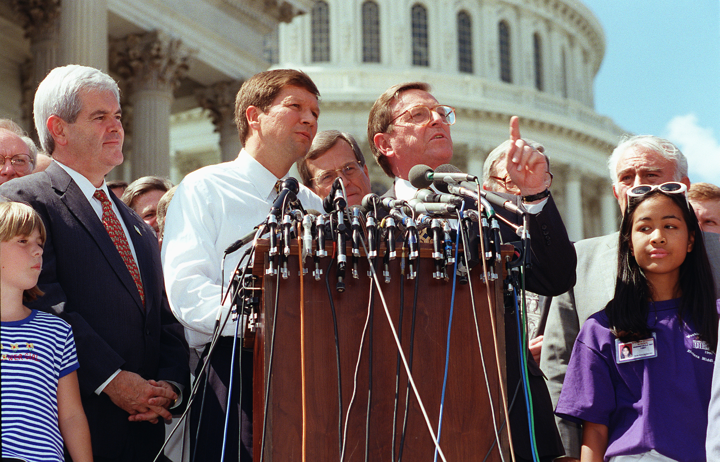 Senate Budget Chairman Pete Domenici, R-N.M., speaking, and House Speaker Newt Gingrich, R-Ga., House Budget Chairman John Kasich, R-Ohio, on July 20, 1997 at a GOP celebration on the House steps of the budget and tax agreement with the White House. (SCOTT J. FERRELL/CQ file photo)