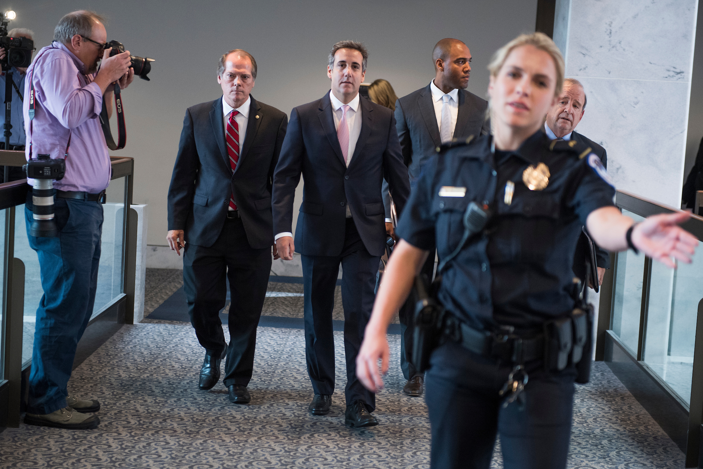 UNITED STATES - SEPTEMBER 19: Michael Cohen, center, a personal attorney for President Trump, leaves Hart Building after his meeting with the Senate Intelligence Committee to discuss Russian interference in the 2016 election was postponed on September 19, 2017. (Photo By Tom Williams/CQ Roll Call)