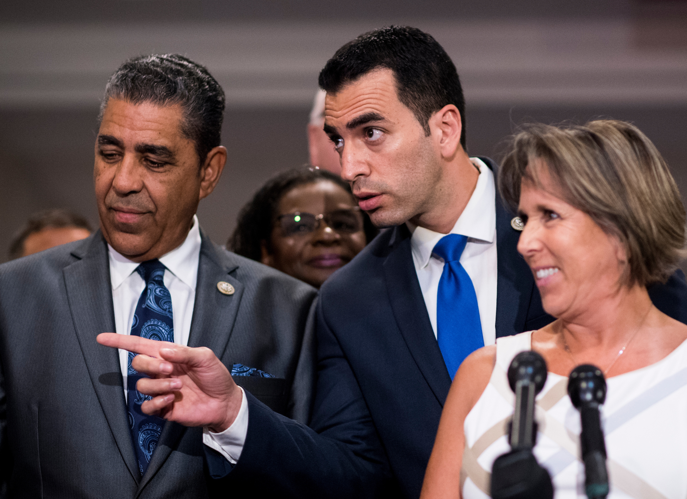 UNITED STATES - SEPTEMBER 5: From left, Rep. Adriano Espaillat, D-N.Y., Rep. Ruben Kihuen, D-Nev., and Congressional Hispanic Caucus chairwoman Rep. Michelle Lujan Grisham, D-N.M., gather in the Capitol with other House Democrats in solidarity with DREAMers and to speak out against President Trump's decision to end DACA on Tuesday, Sept. 5, 2017. Reps. Kihuen and Espaillat are the first formerly undocumented Members to serve in Congress. (Photo By Bill Clark/CQ Roll Call)