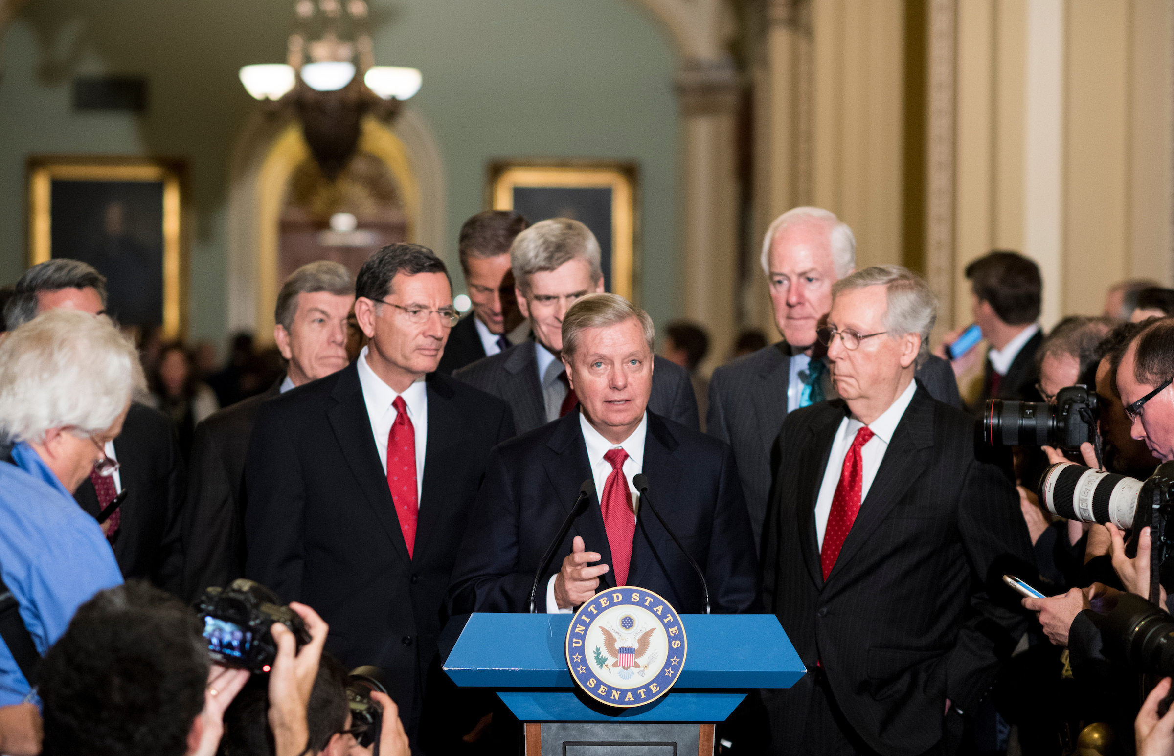 UNITED STATES - SEPTEMBER 26: Sen. Lindsey Graham, R-S.C., flanked from left by Sen. Roy Blunt, R-Mo., Sen. John Barrasso, R-Wyo., Sen. John Thune, R-S. Dak., Sen. Bill Cassidy, R-La., Sen. John Cornyn, R-Texas, and Senate Majority Leader Mitch McConnell, R-Ky., speaks to reporters about the GOP health care bill following the Senate Republicans' policy lunch on Tuesday, Sept. 26, 2017. (Photo By Bill Clark/CQ Roll Call)