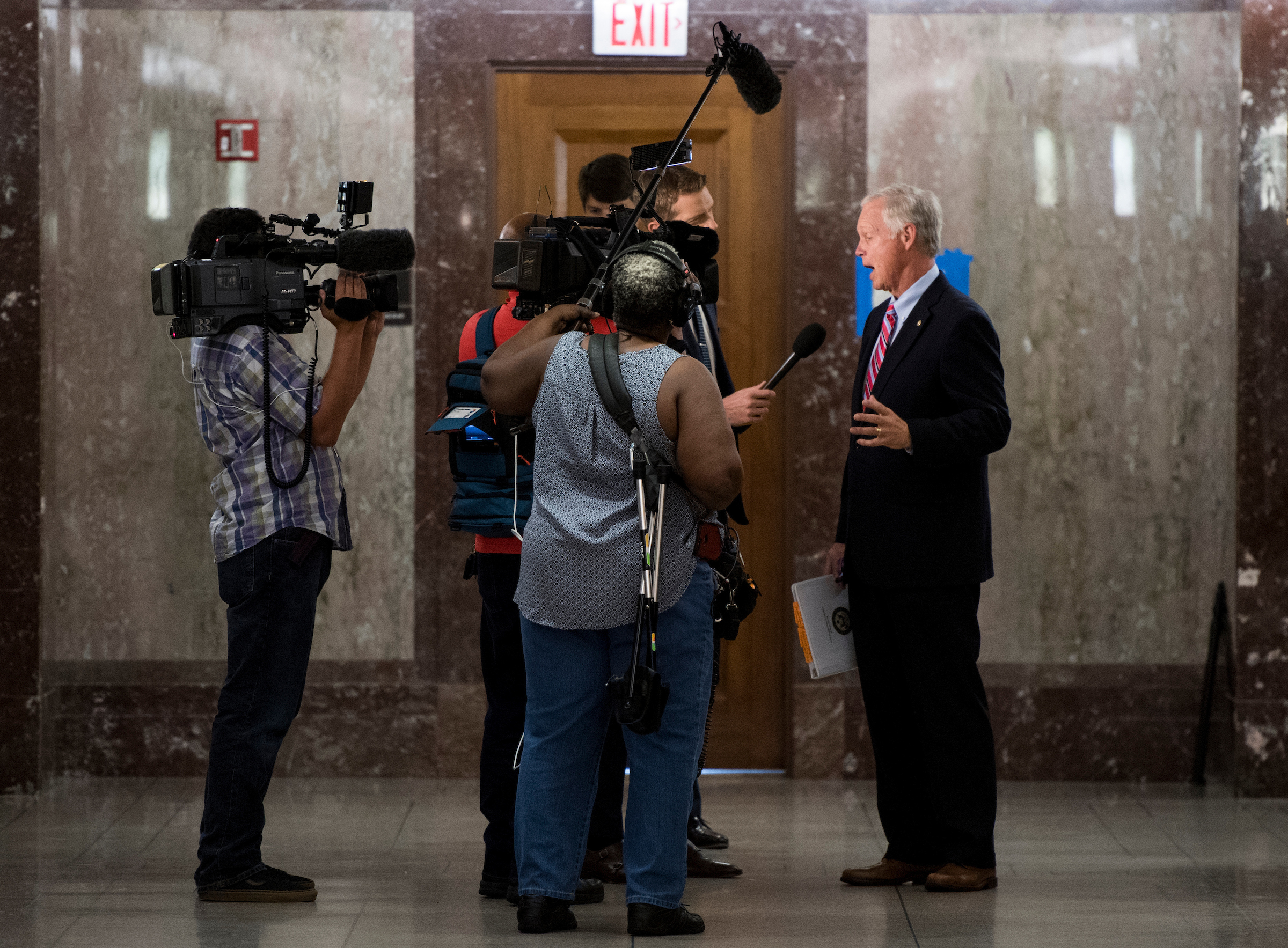 Sen. Ron Johnson, R-Wisc., stops to speak to media as he walks through the Dirksen Senate Office Building on Tuesday, Sept. 19, 2017. (Photo By Bill Clark/CQ Roll Call)