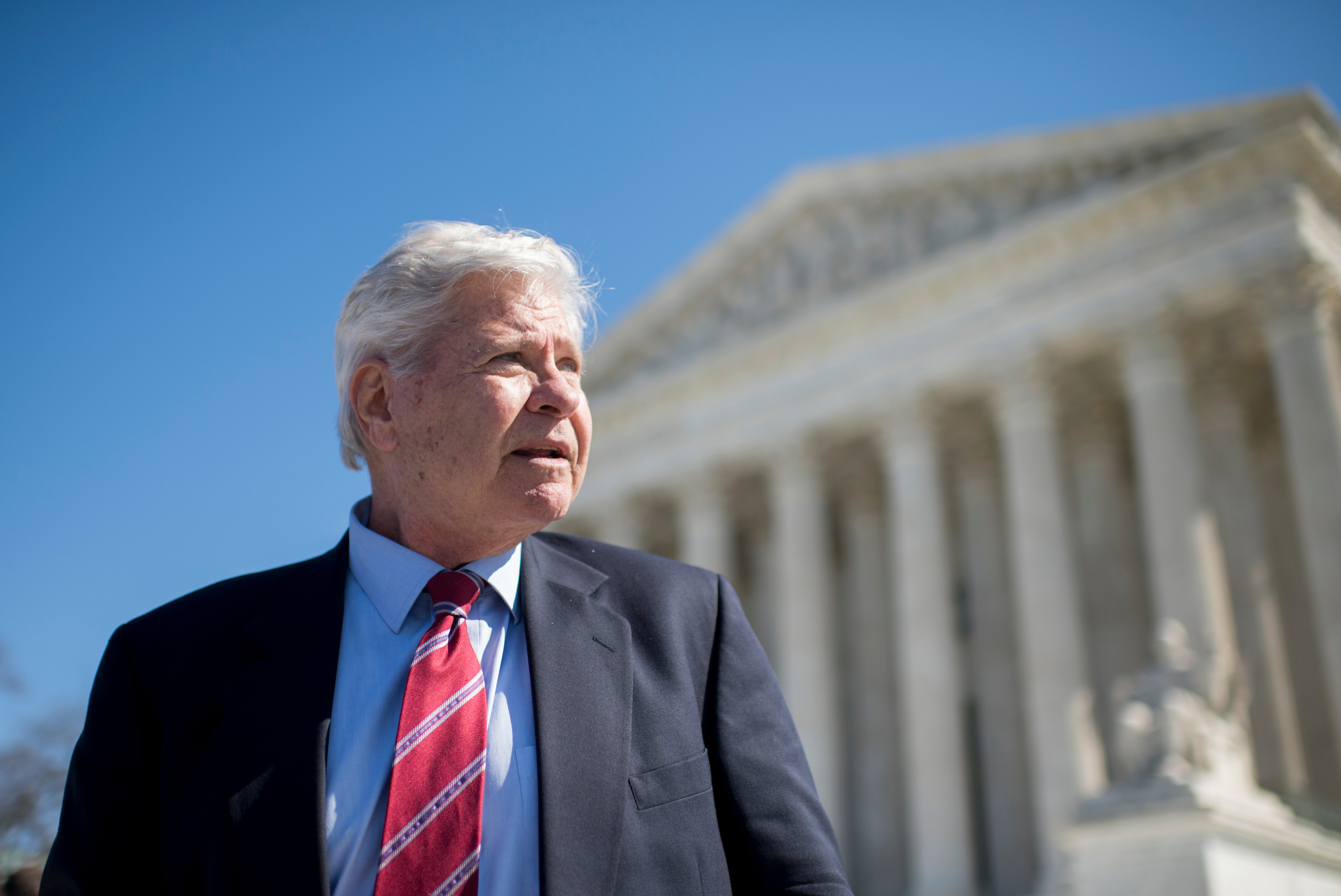 "UNITED STATES - MARCH 23: Former Rep. Ben ""Cooter"" Jones, D-Ga., speaks with reporters outside of the U.S. Supreme Court following arguments in the Walker v. Sons of Confederate Veterans case in Washington on Monday, March 23, 2015. Jones, a member of the Sons of Confederate Veterans, came to the court to support the Texas division of the group suing to allow the Confederate battle flag on license plates. Jones starred as Cooter in the ""Dukes of Hazzard"" television show, and ran against Newt Gingrich in 1994. (Photo By Bill Clark/CQ Roll Call)"