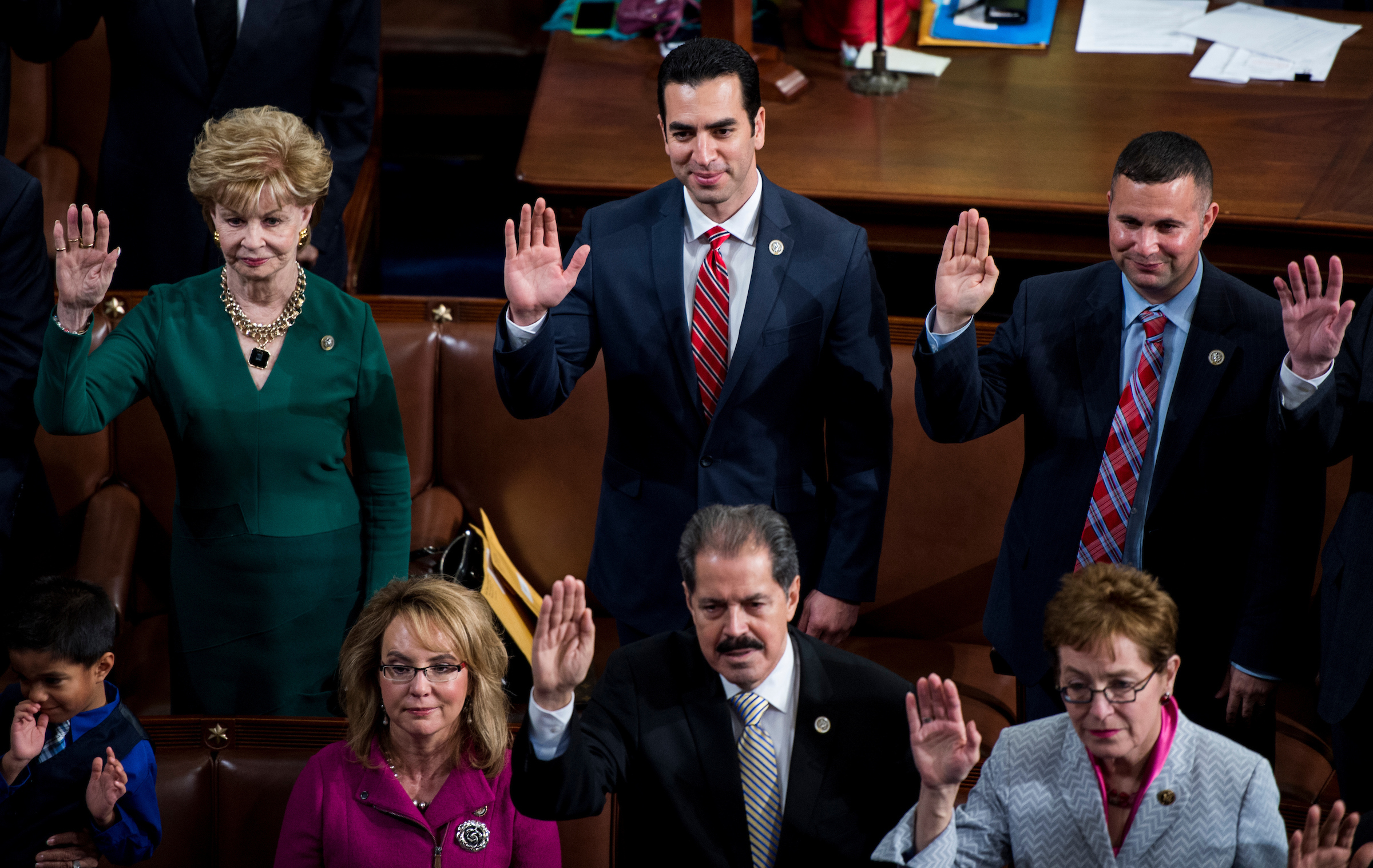 UNITED STATES - JANUARY 3: From left, Del. Madeleine Bordallo, D-Guam, former Rep. Gabby Giffords, D-Ariz., Rep. Ruben Kihuen, D-Nev., Rep. Jose Serrano, D-N.Y., Rep. Darren Soto, D-Fla., and Rep. Marcy Kaptur, D-Ohio, participate in the swearing-in of the 115th Congress on the House floor on Tuesday, Jan. 3, 2017. (Photo By Bill Clark/CQ Roll Call)