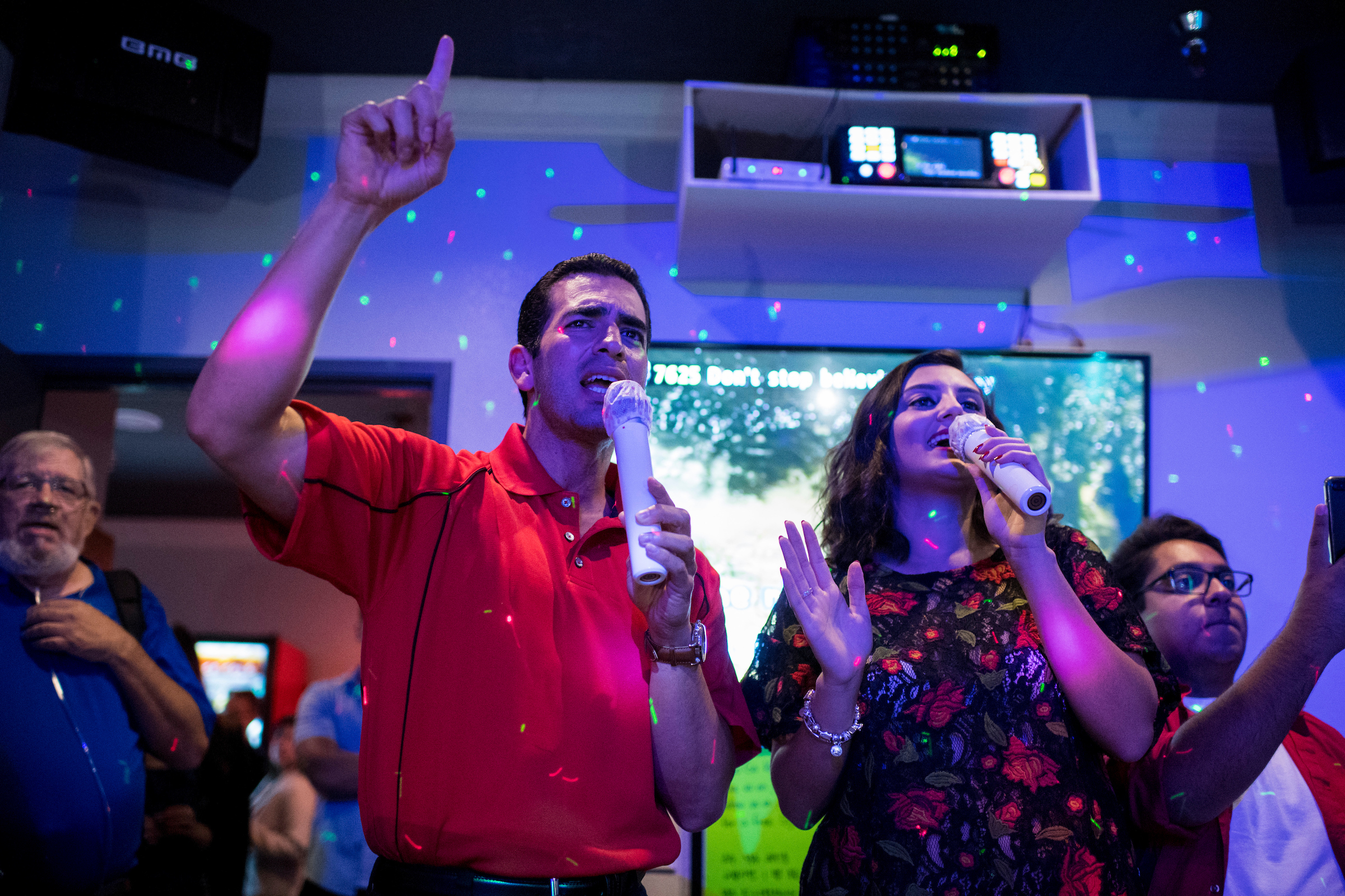 "AUGUST 23: Rep. Ruben Kihuen, D-Nev., sings Journey's ""Don't Stop Believin' "" with Lynette Hull, president of the UNLV Young Democrats, during the ""Karaoke with Kihuen"" event at Go Go Karaoke in Las Vegas on Wednesday, Aug. 23, 2017. The event was organized by the UNLV Young Democrats. (Photo By Bill Clark/CQ Roll Call)"