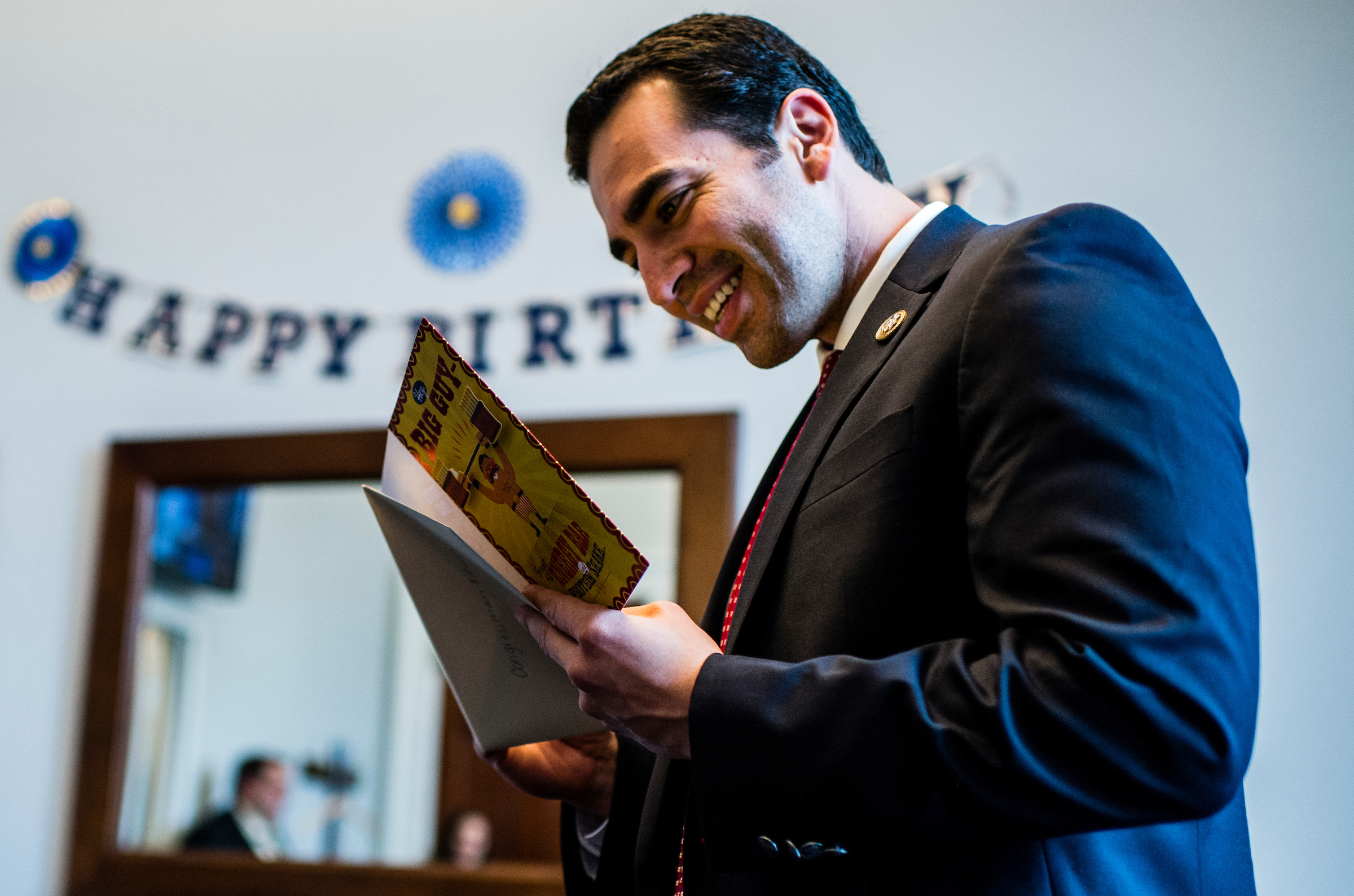 UNITED STATES - APRIL 25: Rep. Ruben Kihuen, D-Nev., reads a birthday card after his staff surprised him with birthday cake in his office on Tuesday, April 25, 2017. (Photo By Bill Clark/CQ Roll Call)