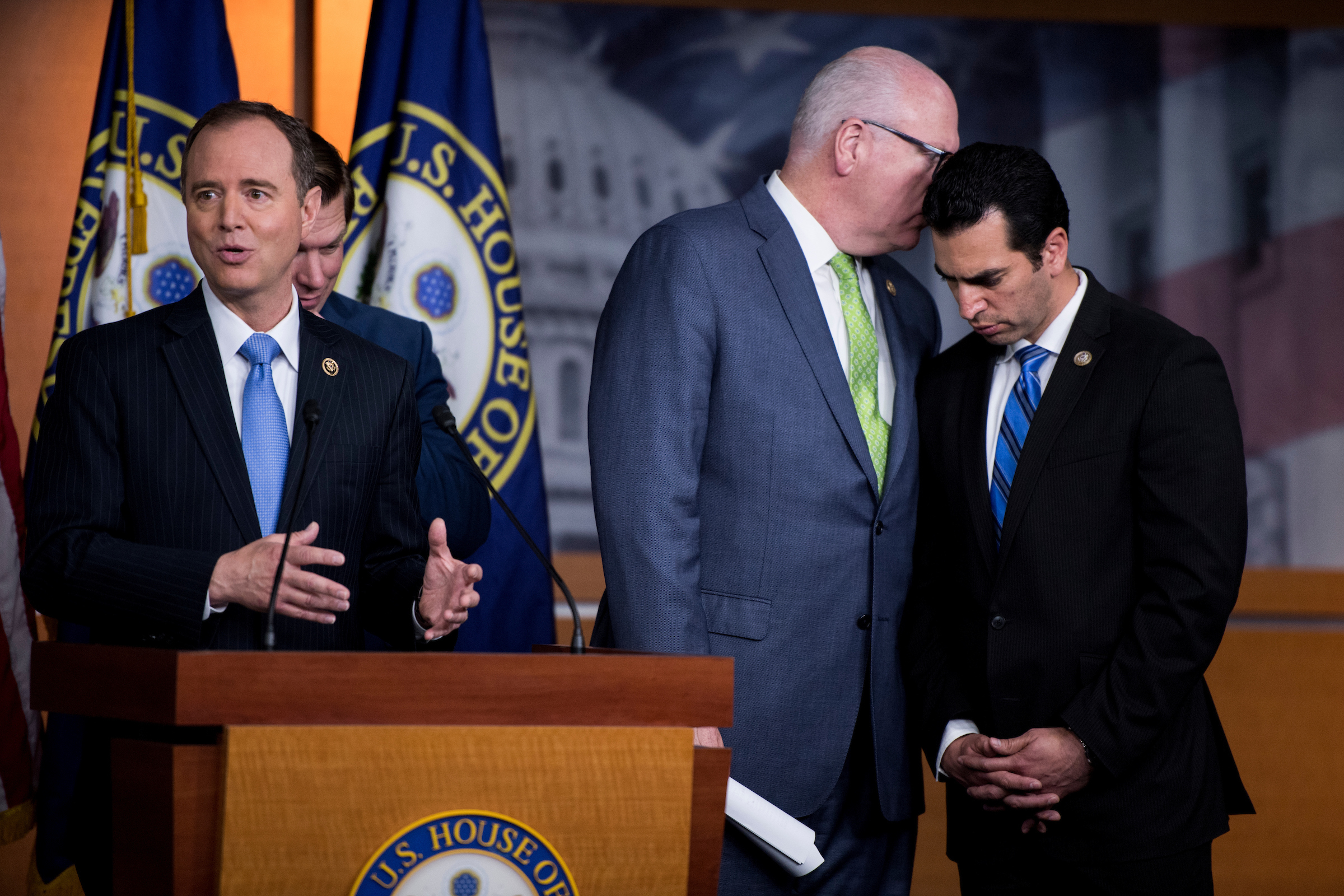 UNITED STATES - MAY 17: Chairman of the Democratic Caucus Rep. Joseph Crowley, D-N.Y., whispers to Rep. Ruben Kihuen, D-Nev., at right as House Intelligence ranking member Adam Schiff, D-Calif. speaks during the House Democrats' news conference on President Trump and Russia ties on Wednesday, May 17, 2017. (Photo By Bill Clark/CQ Roll Call)