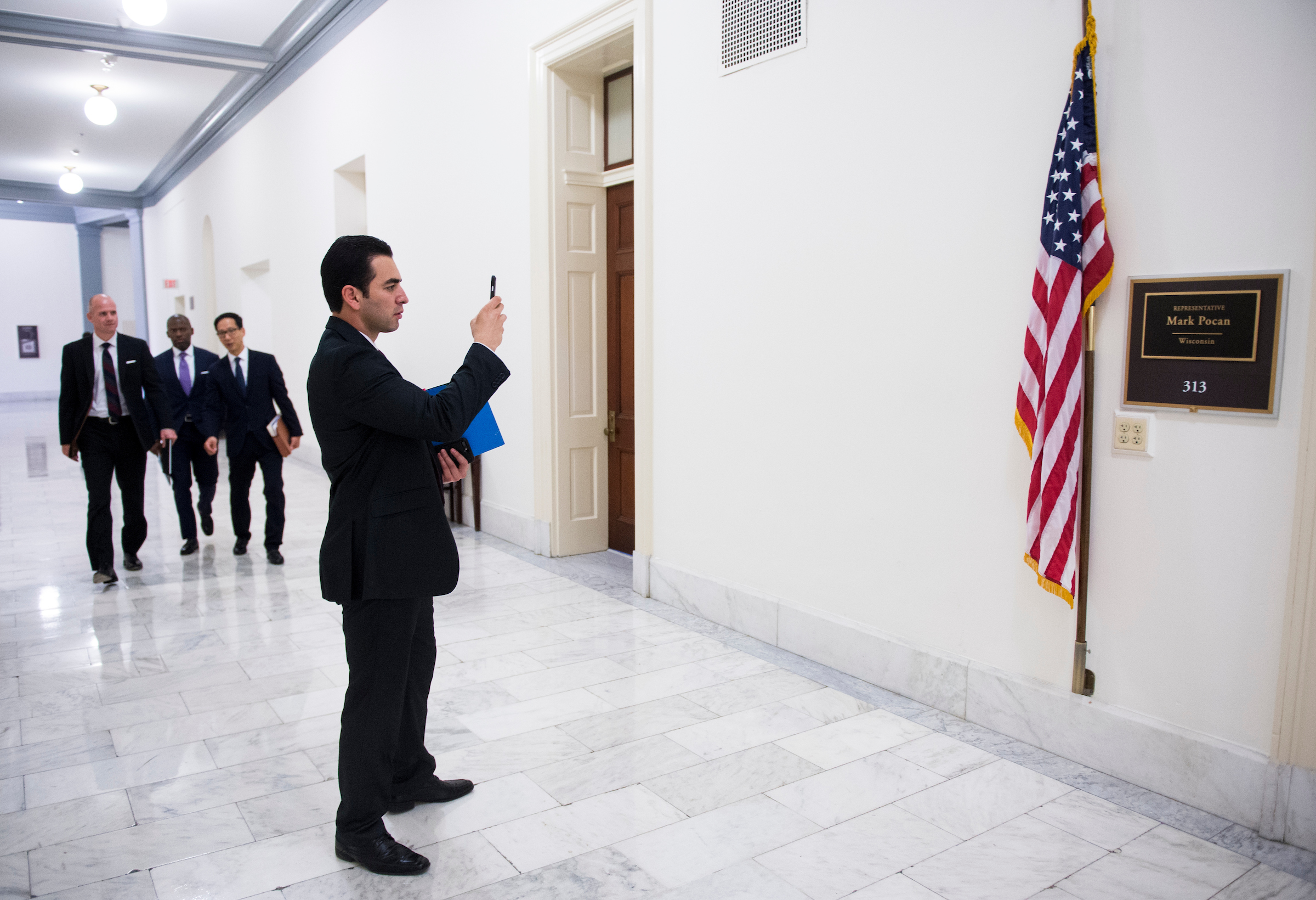 UNITED STATES - DECEMBER 1: Rep.-elect Ruben Kihuen, D-Nev., takes photos of his new office in the Cannon House Office Building after the New Member Orientation Room Lottery Draw for office space at the Capitol on December 1, 2016. (Photo By Bill Clark/CQ Roll Call)