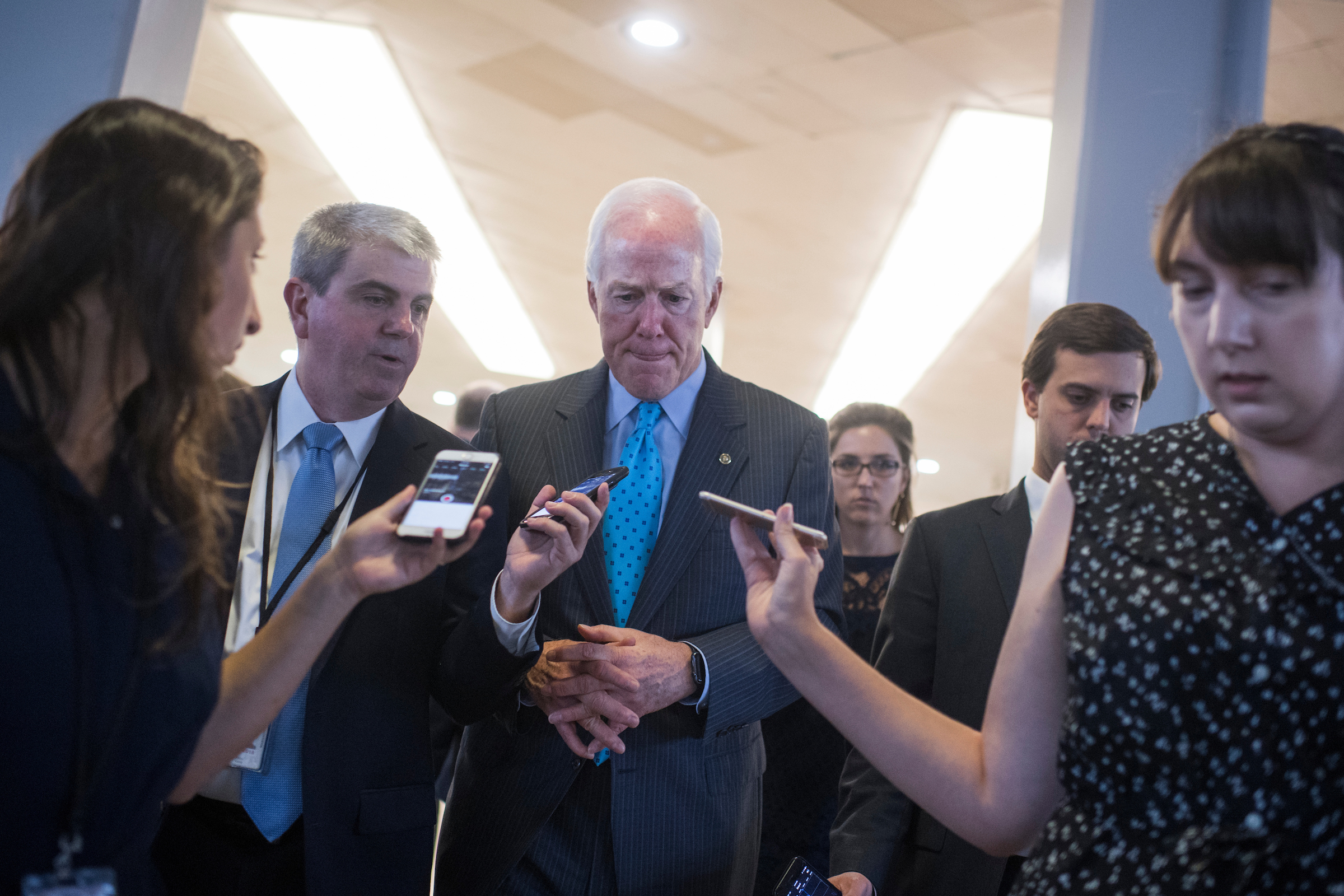 UNITED STATES - SEPTEMBER 26: Senate Majority Whip John Cornyn, R-Texas, talks with reporters after Majority Leader Mitch McConnell, R-Ky., announced the latest plan to repeal and replace the Affordable Care Act had been pulled on September 26, 2017. (Photo By Tom Williams/CQ Roll Call)