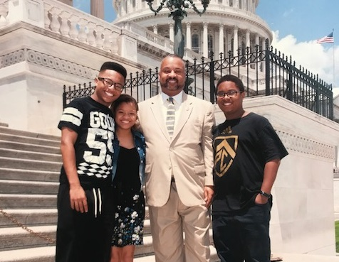 Rep. Donald Payne Jr., with his triplets, XXX, XXX, and XXX. (Courtesy Payne's office)