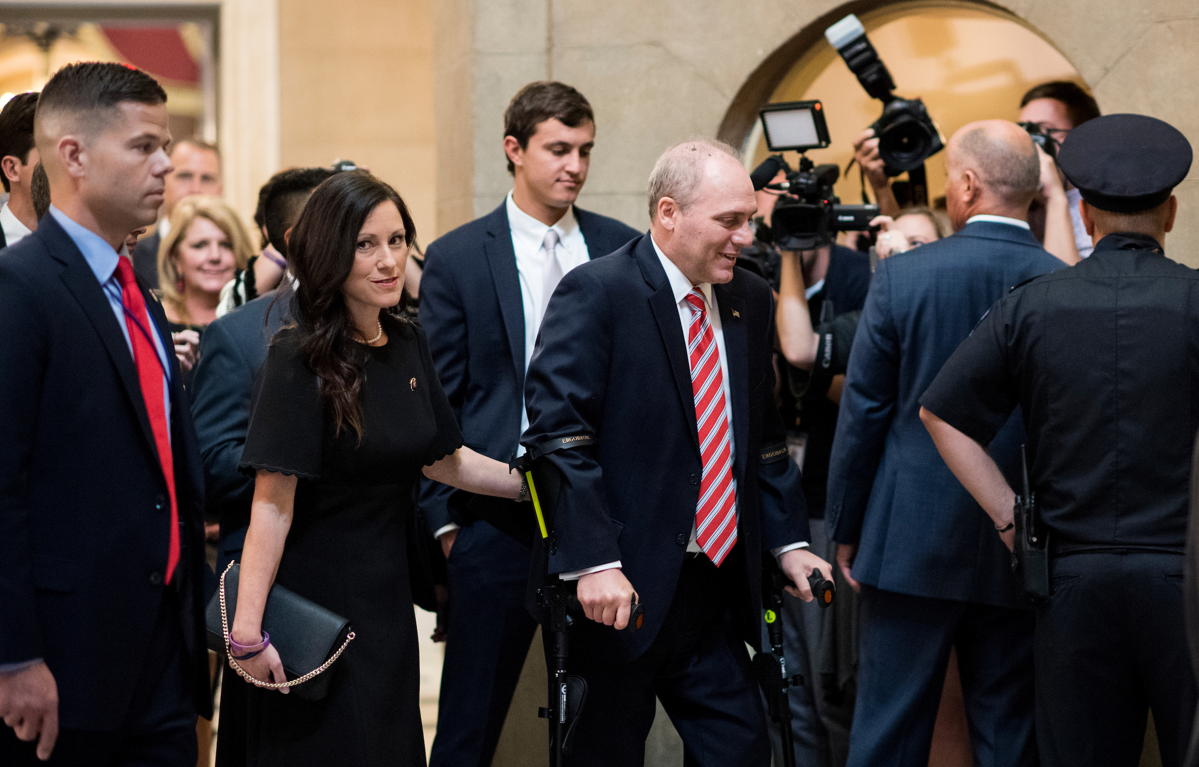 UNITED STATES - SEPTEMBER 28: House Majority Whip Steve Scalise, R-La., walks with his wife Jennifer from the House chamber to his office in the Capitol on his first day back in Congress on Thursday, Sept. 28, 2017. Scales was shot during baseball practice for the Congressional Baseball Game in June. (Photo By Bill Clark/CQ Roll Call)