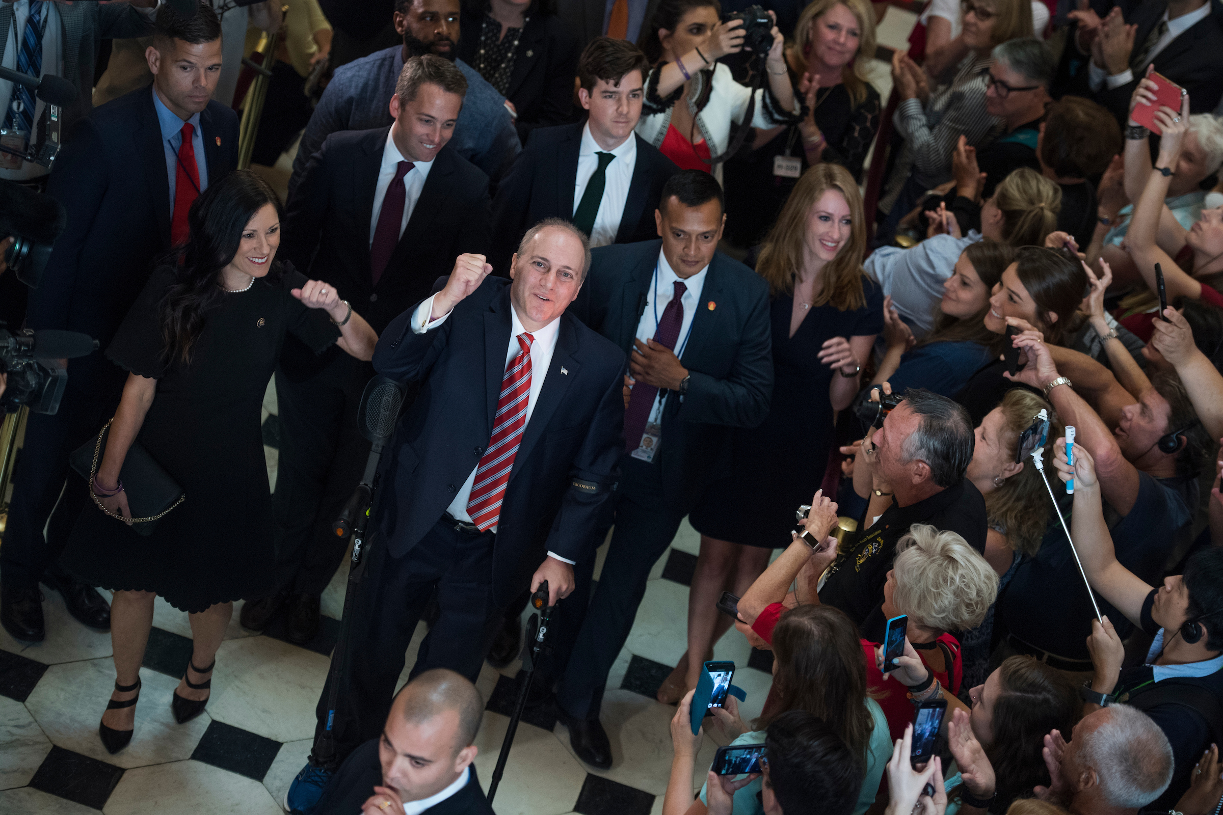 UNITED STATES - SEPTEMBER 28: House Majority Whip Steve Scalise, R-La., and his wife Jennifer, walk through the Capitol's Statuary Hall on September 28, 2017, his first day back to the Hill after being injured in the shooting at the Republican baseball practice in June. (Photo By Tom Williams/CQ Roll Call)