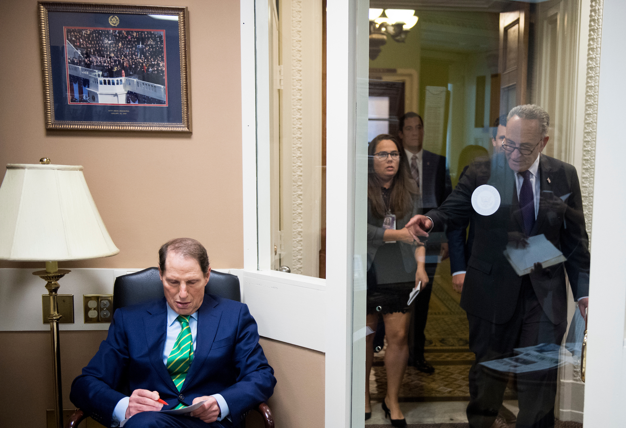 UNITED STATES - SEPTEMBER 27: Sen. Ron Wyden, D-Ore., left, waits for Senate Minority Leader Chuck Schumer, D-N.Y., to arrive for their press conference on the GOP tax reform plan on Wednesday, Sept. 27, 2017. (Photo By Bill Clark/CQ Roll Call)