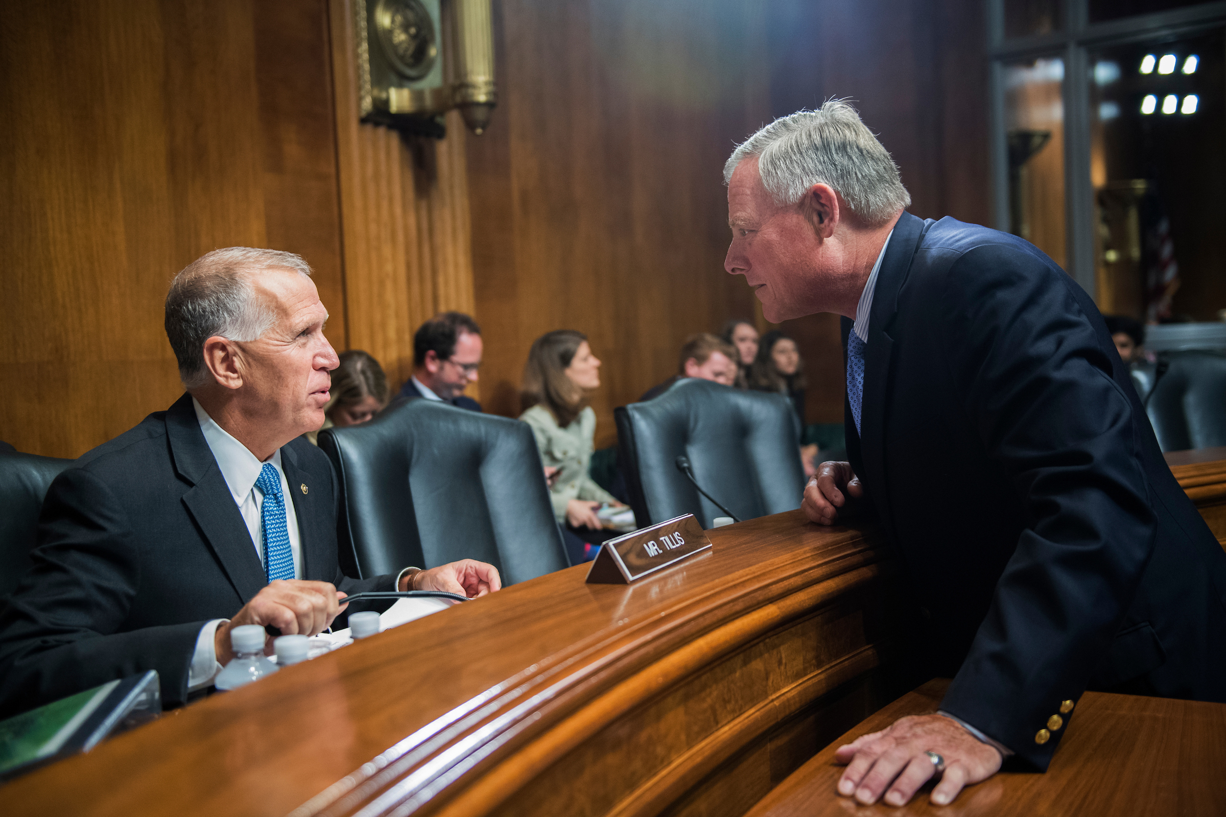 UNITED STATES - SEPTEMBER 20: Sens. Richard Burr, R-N.C., right, and Thom Tillis, R-N.C. prepare for a Senate Judiciary Committee hearing in Dirksen on judicial nominations on September 20, 2017. (Photo By Tom Williams/CQ Roll Call)