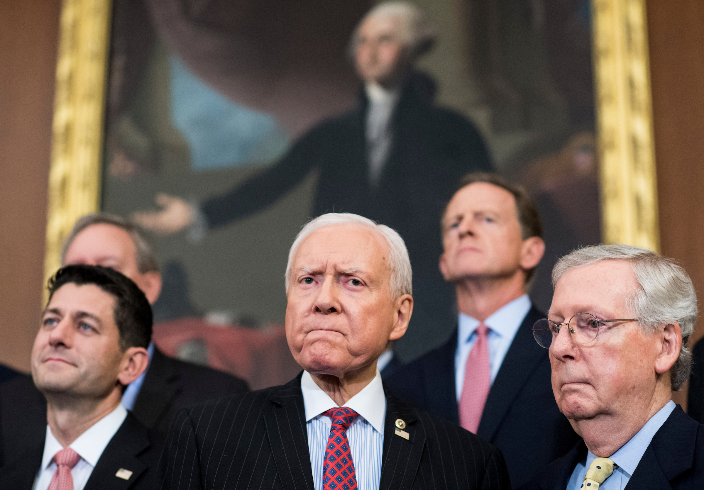 UNITED STATES - SEPTEMBER 27: From left, Speaker of the House Paul Ryan, R-Wisc., Senate Finance Committee chairman Orrin Hatch, R-Utah, and Senate Majority Leader Mitch McConnell, R-Ky., participate in the Congressional GOP media availability to unveil the GOP tax reform plan in the Capitol on Wednesday, Sept. 27, 2017. (Photo By Bill Clark/CQ Roll Call)