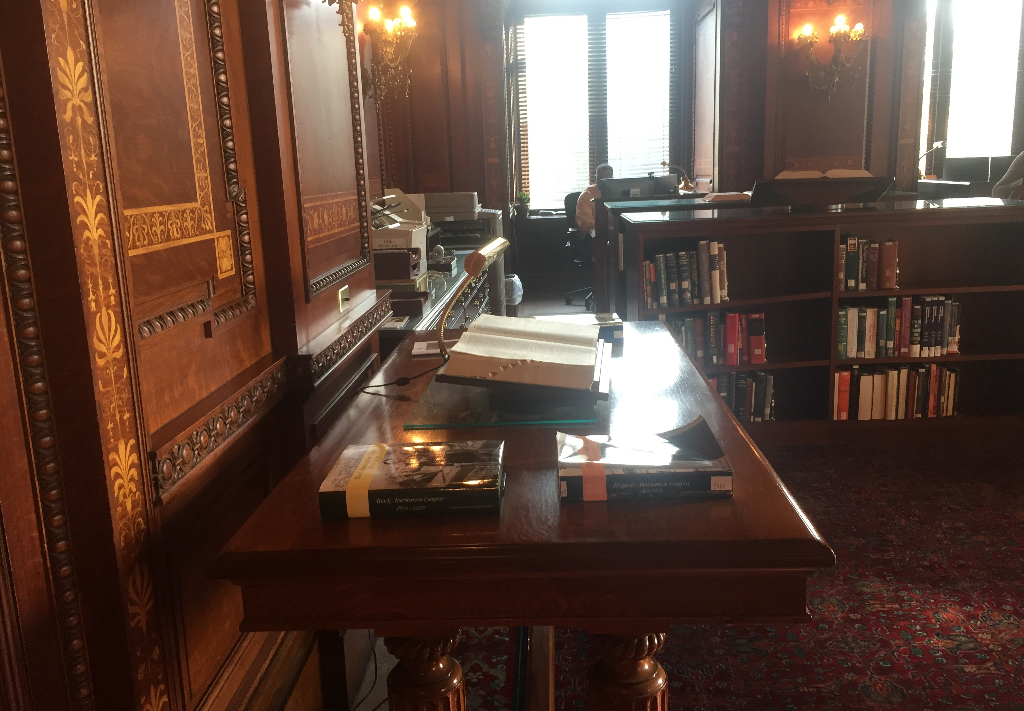A CRS docent always sits in the Congressional Reading Room. (Alex Gangitano/CQ Roll Call)