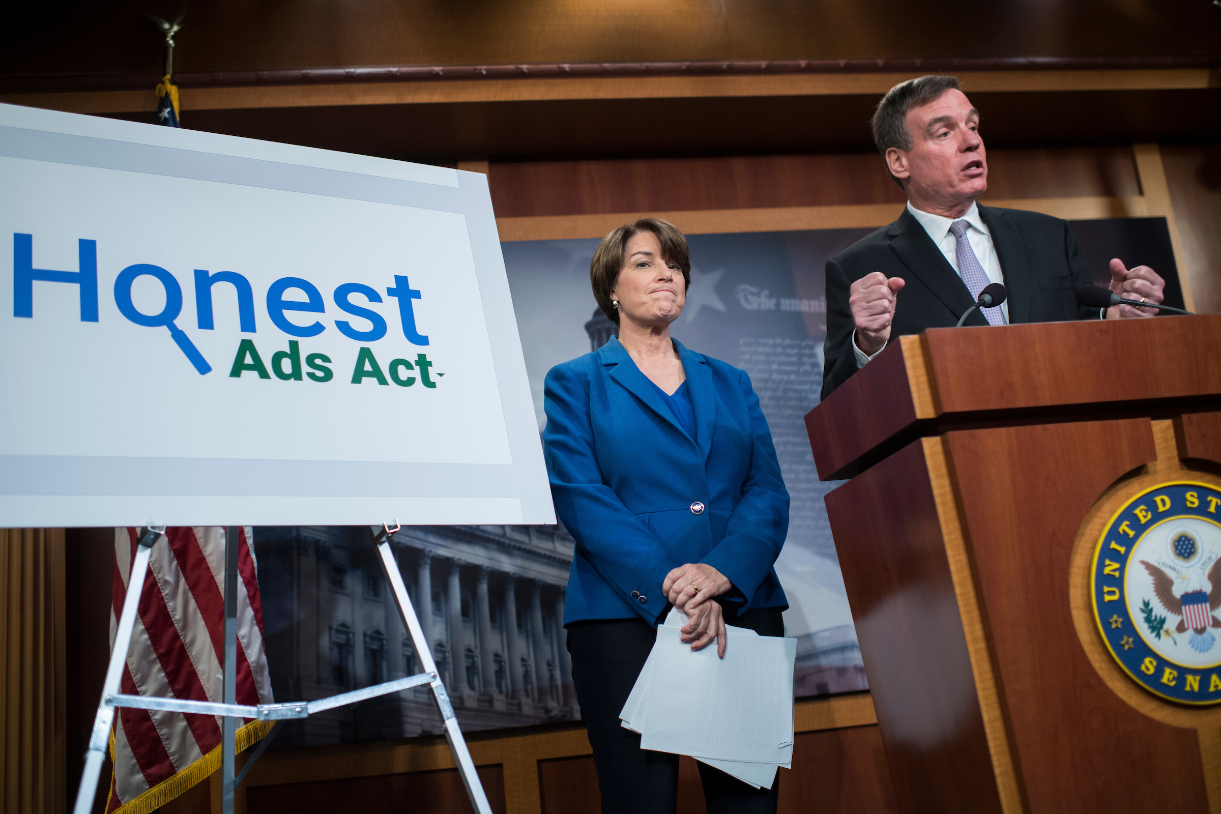 UNITED STATES - OCTOBER 19: Sens. Amy Klobuchar, D-Minn., and Mark Warner, D-Va., conduct a news conference in the Capitol on the Honest Ads Act which aims to make online political ads more transparent on October 19, 2017. (Photo By Tom Williams/CQ Roll Call)