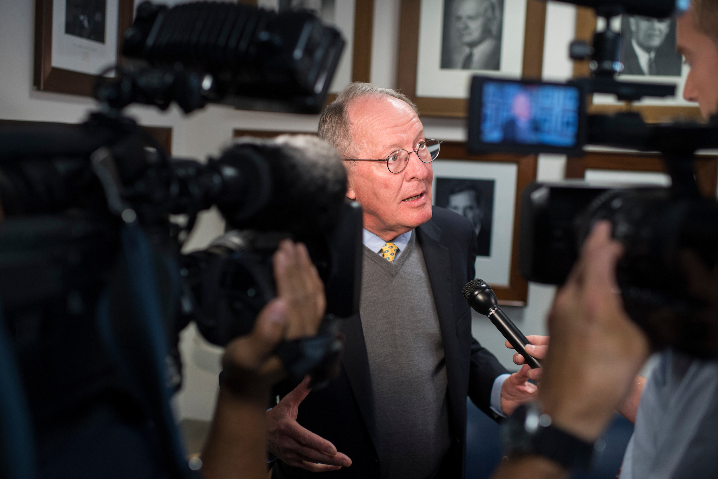 UNITED STATES - OCTOBER 18: Chairman Lamar Alexander, R-Tenn., talks with reporters after a Senate Health, Education, Labor and Pensions Committee markup in Dirksen Building on October 18, 2017. (Photo By Tom Williams/CQ Roll Call)