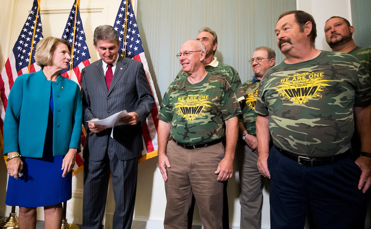 Sens. Shelley Moore Capito, R-W.Va., and Joe Manchin III, D-W. Va., talk during their press conference on the introduction of the American Miners Pension Act. (Bill Clark/CQ Roll Call)