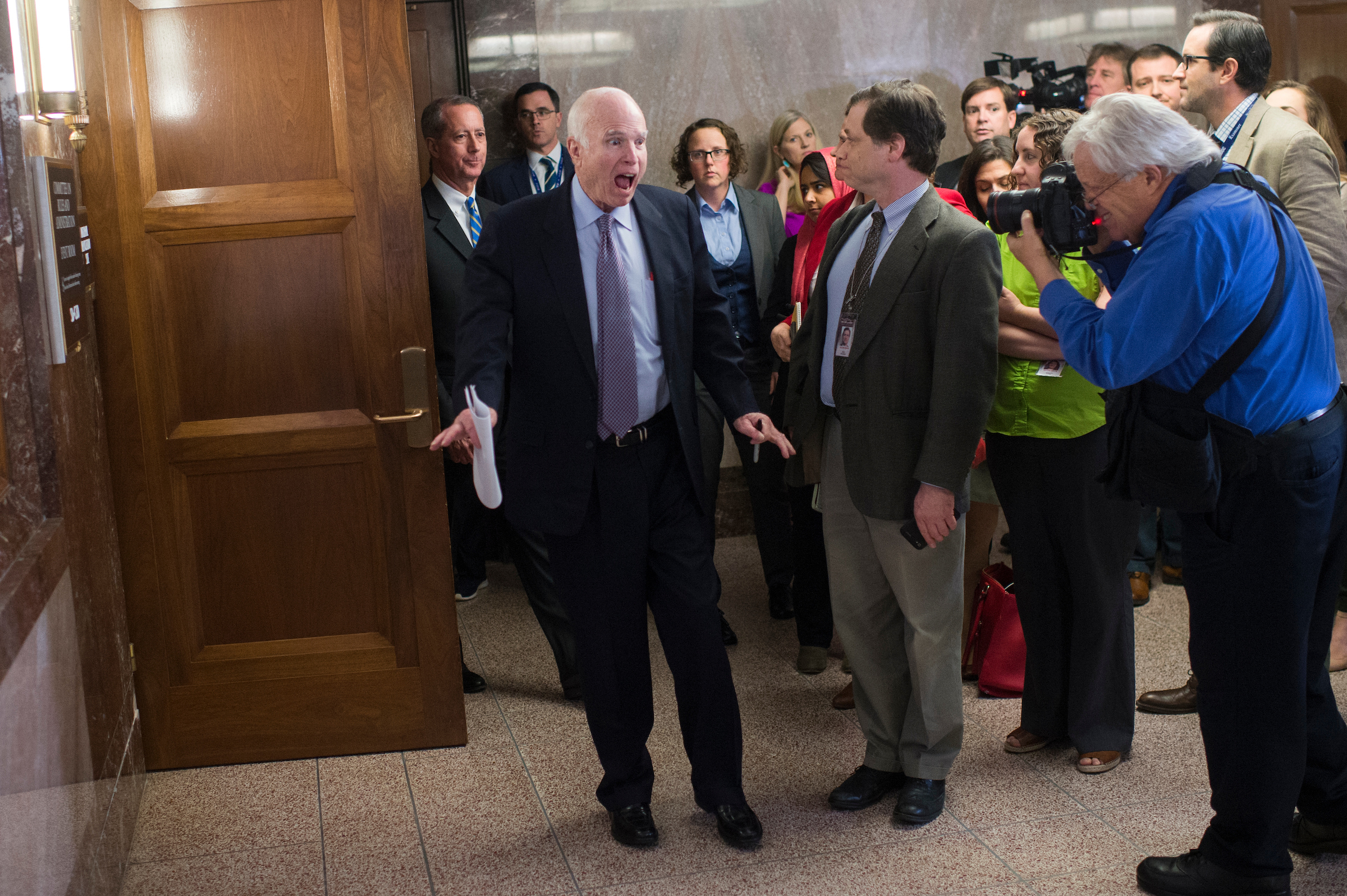 Senate Armed Services Committee Chairman John McCain, R-Ariz., center, and House Armed Services Committee Chairman Mac Thornberry, R-Texas, left, arrive for a news conference before a National Defense Authorization Act (NDAA) conferees meeting in Dirksen Building. (Tom Williams/CQ Roll Call)