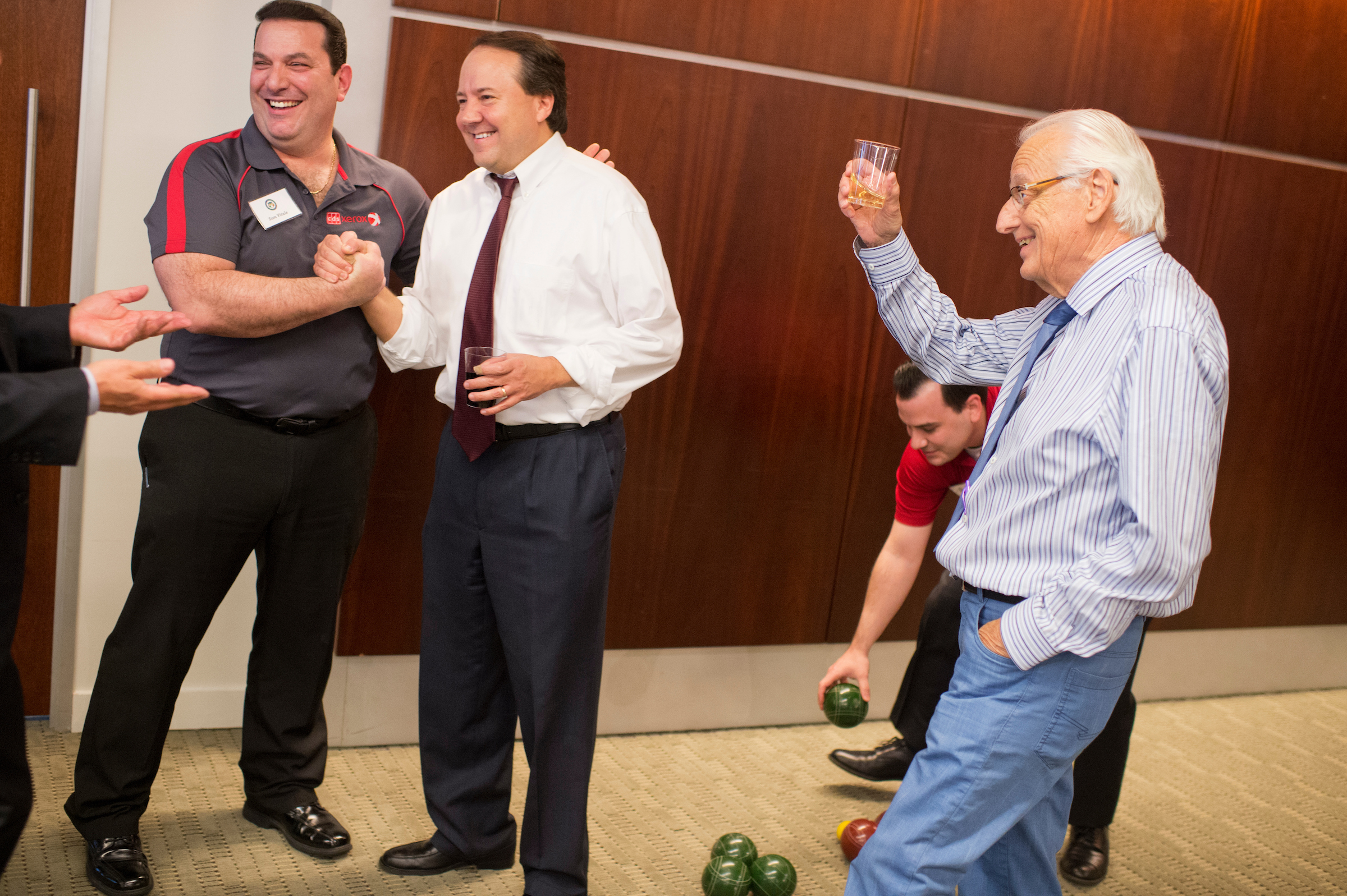 UNITED STATES - MAY 23: From left, Sam Vitale of Xerox, Rep. Pat Tiberi, R-Ohio, Jon Vitale, and Rep. Bill Pascrell, D-N.J., conclude a match where the Congress team was victorious during the Fourth Annual Congressional Bocce Ball Tournament sponsored by the National Italian American Foundation (NIAF), in the offices of Venable LLP law firm, May 23, 2016. Play was moved inside because of rain. (Photo By Tom Williams/CQ Roll Call)