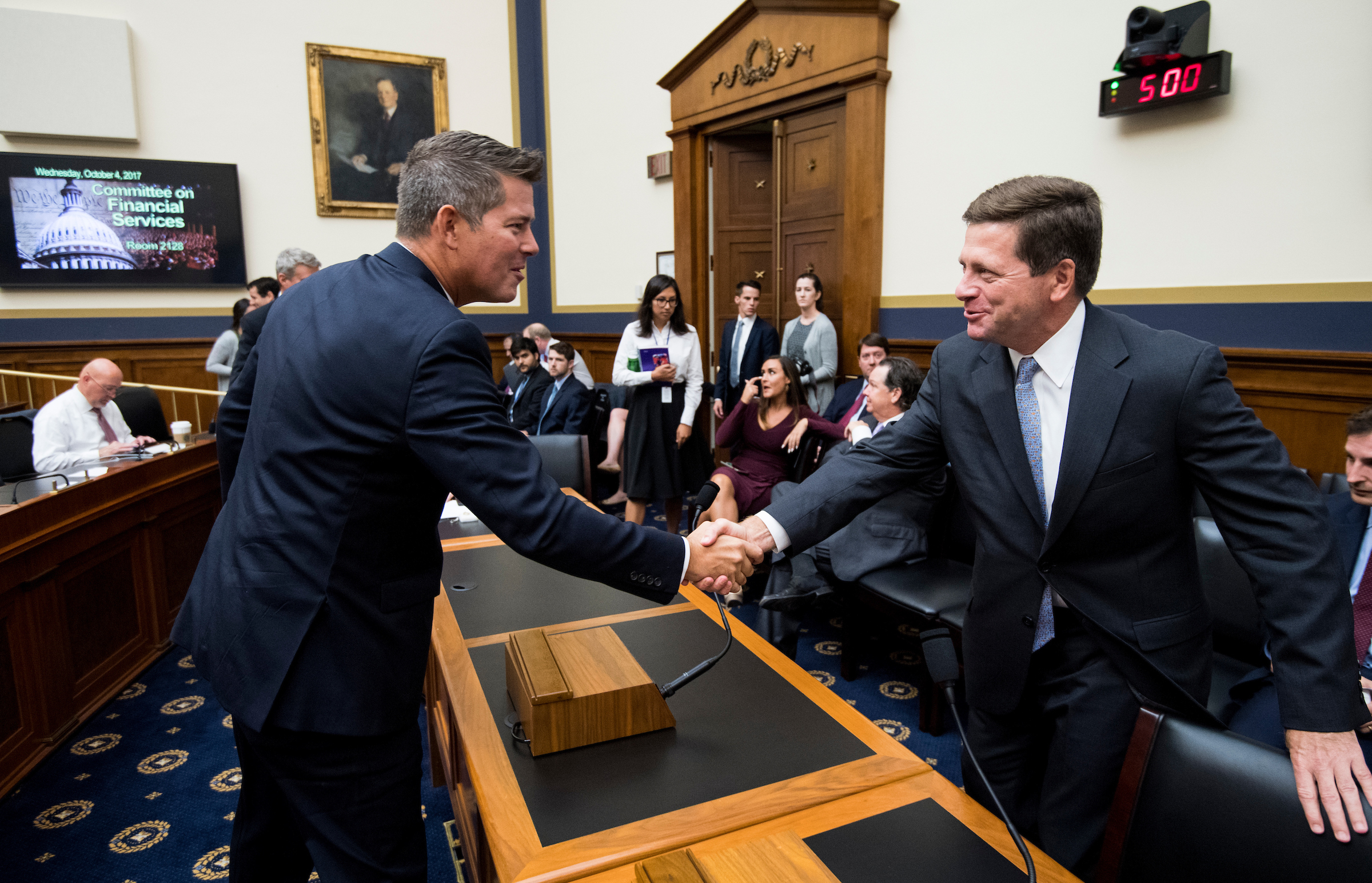"UNITED STATES - OCTOBER 4: Rep. Sean Duffy, R-Wisc., shakes hands with SEC Chairman Jay Clayton before the start of the House Financial Services Committee hearing on ""Examining the SEC's Agenda, Operations, and Budget"" on Wednesday, Oct. 4, 2017.(Photo By Bill Clark/CQ Roll Call)"
