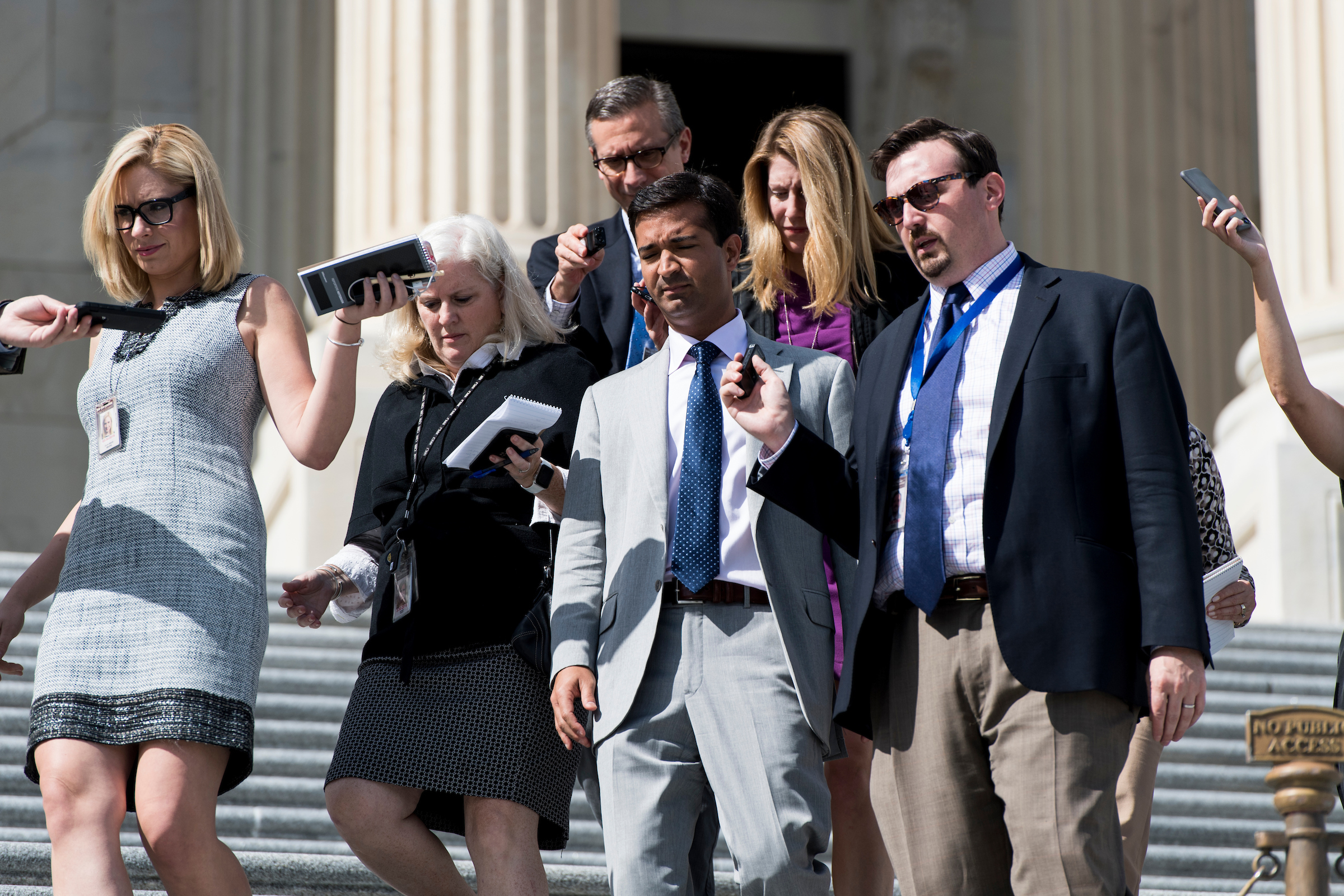 UNITED STATES - OCTOBER 5: Rep. Carlos Curbelo, R-Fla., speaks with reporters as he walks down the House steps after the last votes of the week on Thursday, Oct. 5, 2017. (Photo By Bill Clark/CQ Roll Call)