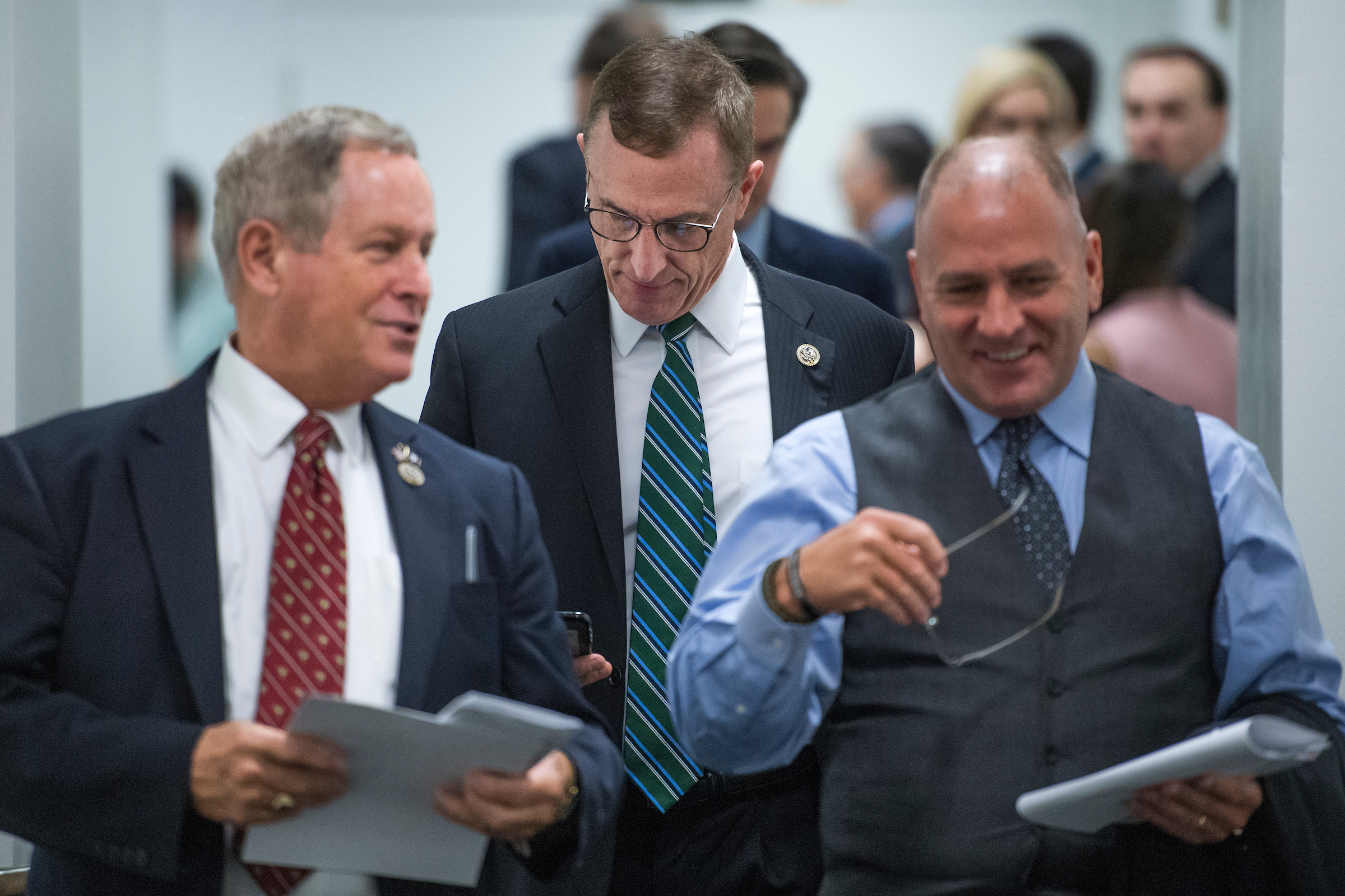 UNITED STATES - OCTOBER 11: From left, Reps. Joe Wilson, R-S.C., Tim Murphy, R-Pa., and Clay Higgins, R-La., leave a meeting of the House Republican Conference in the Capitol on October 11, 2017. (Photo By Tom Williams/CQ Roll Call)