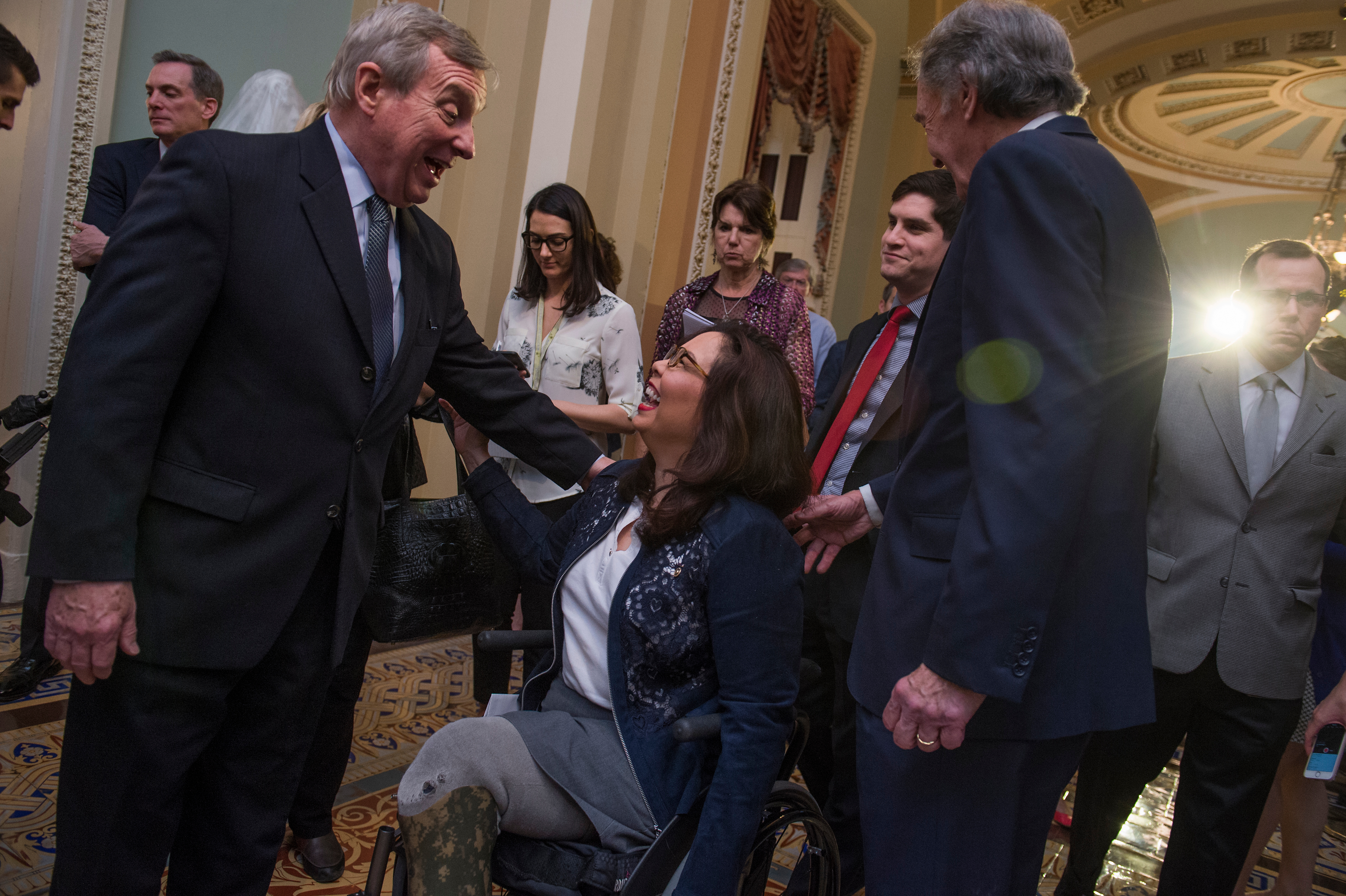 UNITED STATES - MAY 16: From left, Senate Minority Whip Richard Durbin, D-Ill., Sens. Tammy Duckworth, D-Ill., and Ed Markey, D-Mass., conclude a news conference after the Senate Policy luncheons in the Capitol on May 16, 2017. (Photo By Tom Williams/CQ Roll Call)
