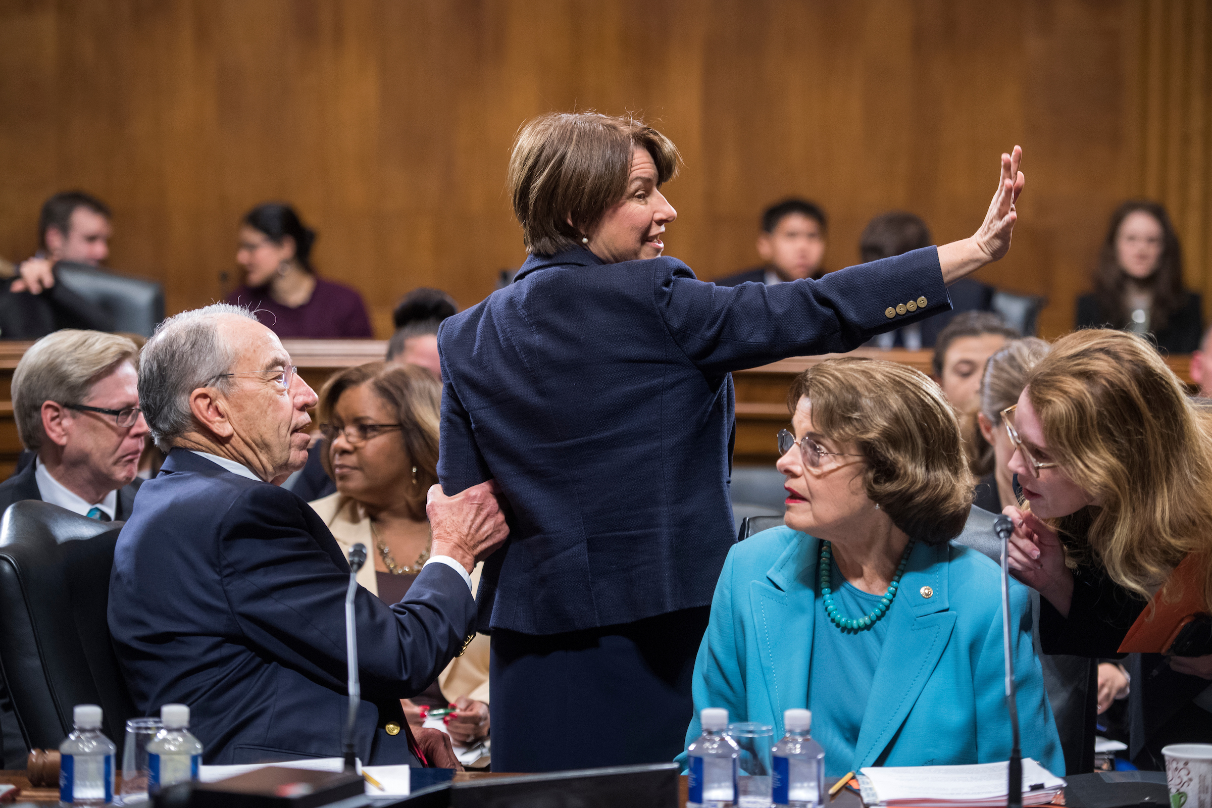 UNITED STATES - OCTOBER 26: From left, Chairman Charles Grassley, R-Iowa, Amy Klobuchar, D-Minn., and Dianne Feinstein, D-Calif., ranking member, are seen during a Senate Judiciary Committee markup on judicial nominations in Dirksen Building on October 26, 2017. (Photo By Tom Williams/CQ Roll Call)