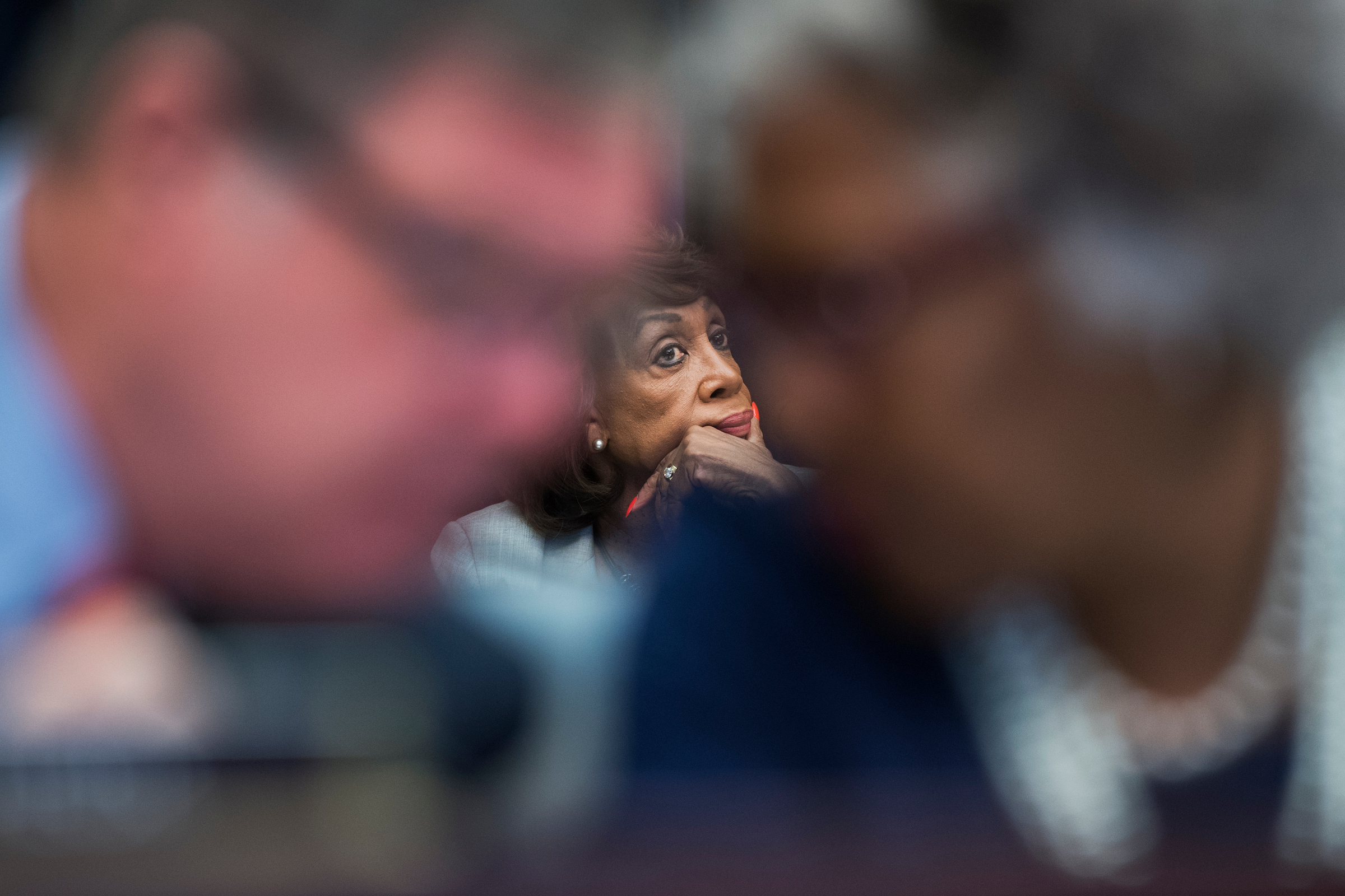 UNITED STATES - OCTOBER 11: Rep. Maxine Waters, D-Calif., center, ranking member of the House Financial Services Committee, attends a markup in Rayburn Building on October 11, 2017. Reps. Joyce Beatty, D-Ohio, and Denny Heck, D-Wash., also appear. (Photo By Tom Williams/CQ Roll Call)