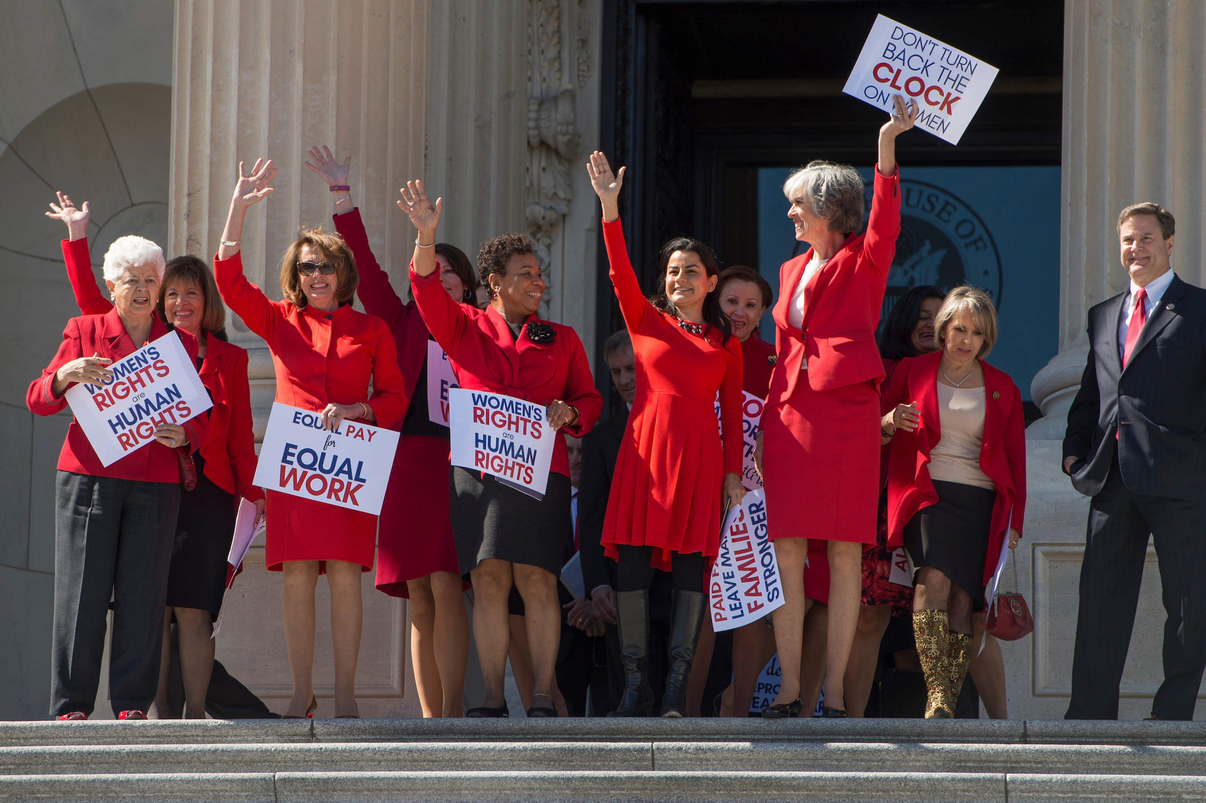 UNITED STATES - MARCH 8: From left, Reps. Grace Napolitano, D-Calif., Jackie Speier, D-Calif., House Minority Leader Nancy Pelosi, D-Calif., Cheri Bustos, D-Ill., Barbara Lee, D-Calif., Nanette Barragan, D-Calif., Nydia Velazquez, D-N.Y., Katherine Clark, D-Mass., and Michelle Lujan Grisham, D-N.M., wear red as they descend the House steps after walking out of the House Chamber to support A Day Without A Woman rallies happening across the country, March 8, 2017. The rallies coincide with International Women's Day. (Photo By Tom Williams/CQ Roll Call)