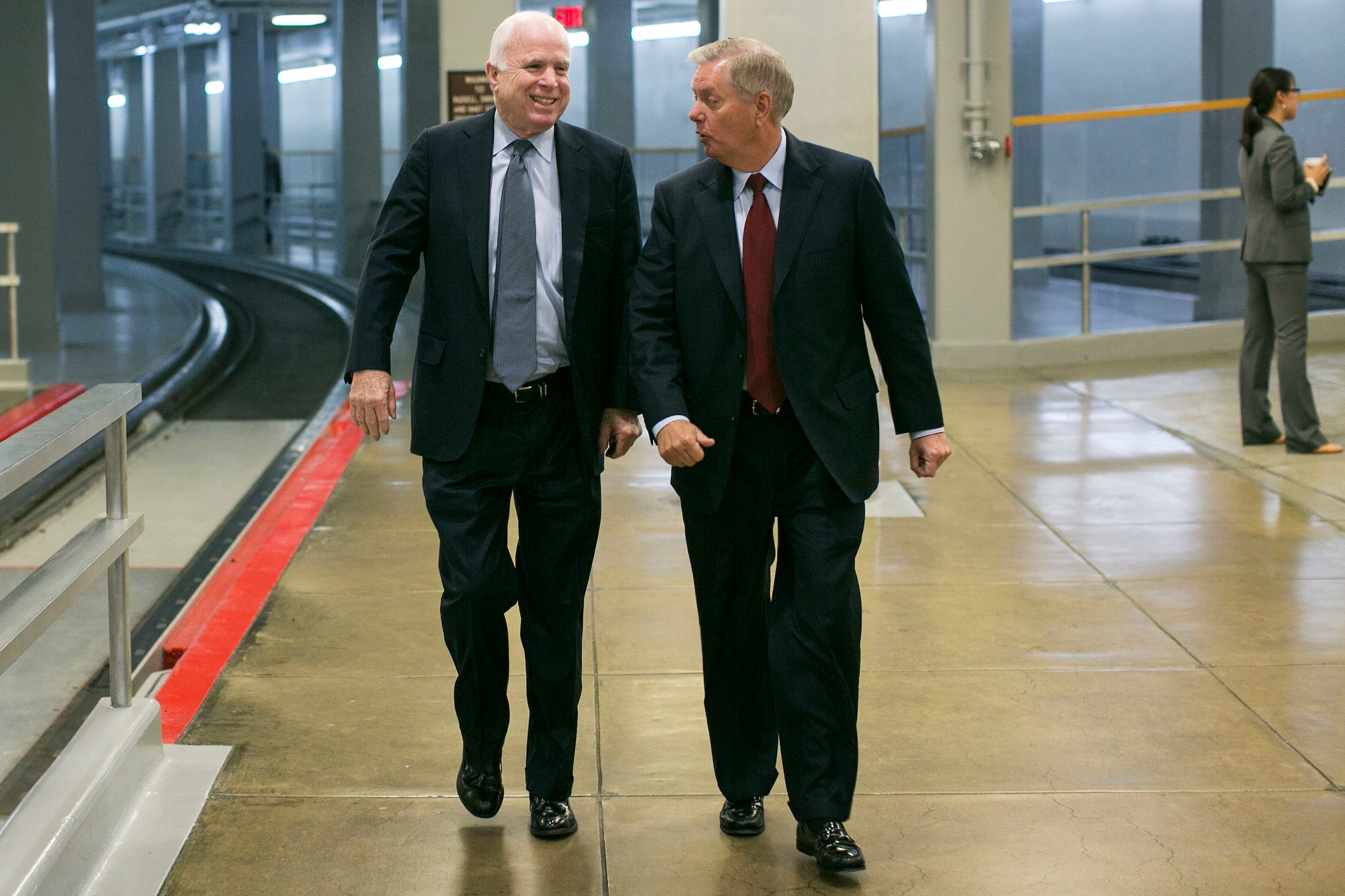 UNITED STATES - MAY 11 - Sen. John McCain, R-Ariz., and Sen. Lindsey Graham, R-S.C., joke as they arrive in the basement of the U.S. Capitol for a vote, in Washington, Wednesday, May 11, 2016. (Photo By Al Drago/CQ Roll Call)