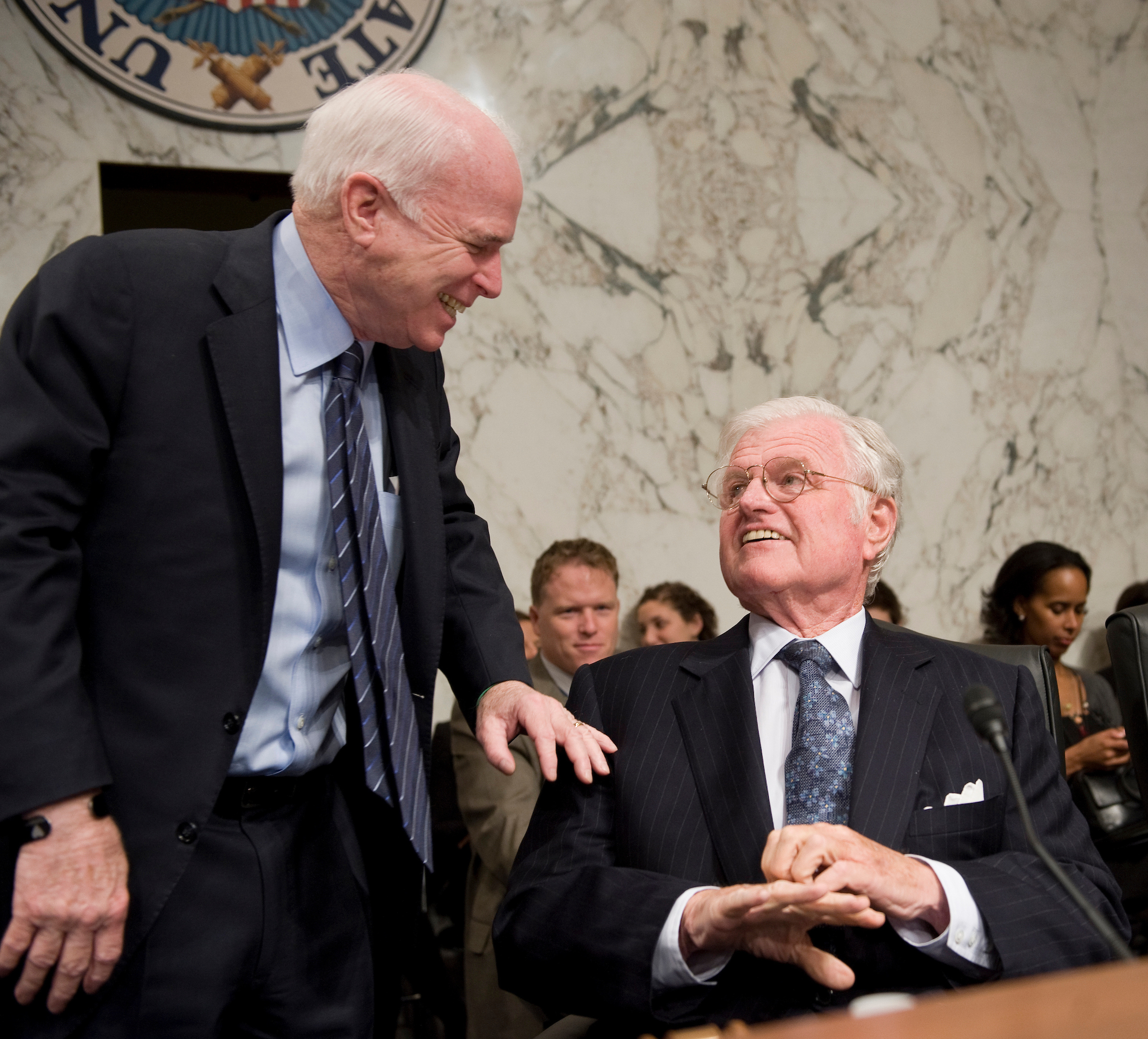 Sen. John McCain, R-Ariz., talks with Sen. Ted Kennedy, D-Mass., chairman of the Senate Health, Education, Labor, and Pensions Committee, during the confirmation hearing of Kathleen Sebelius, nominee for Secretary of Health and Human Services, March 31, 2009.
