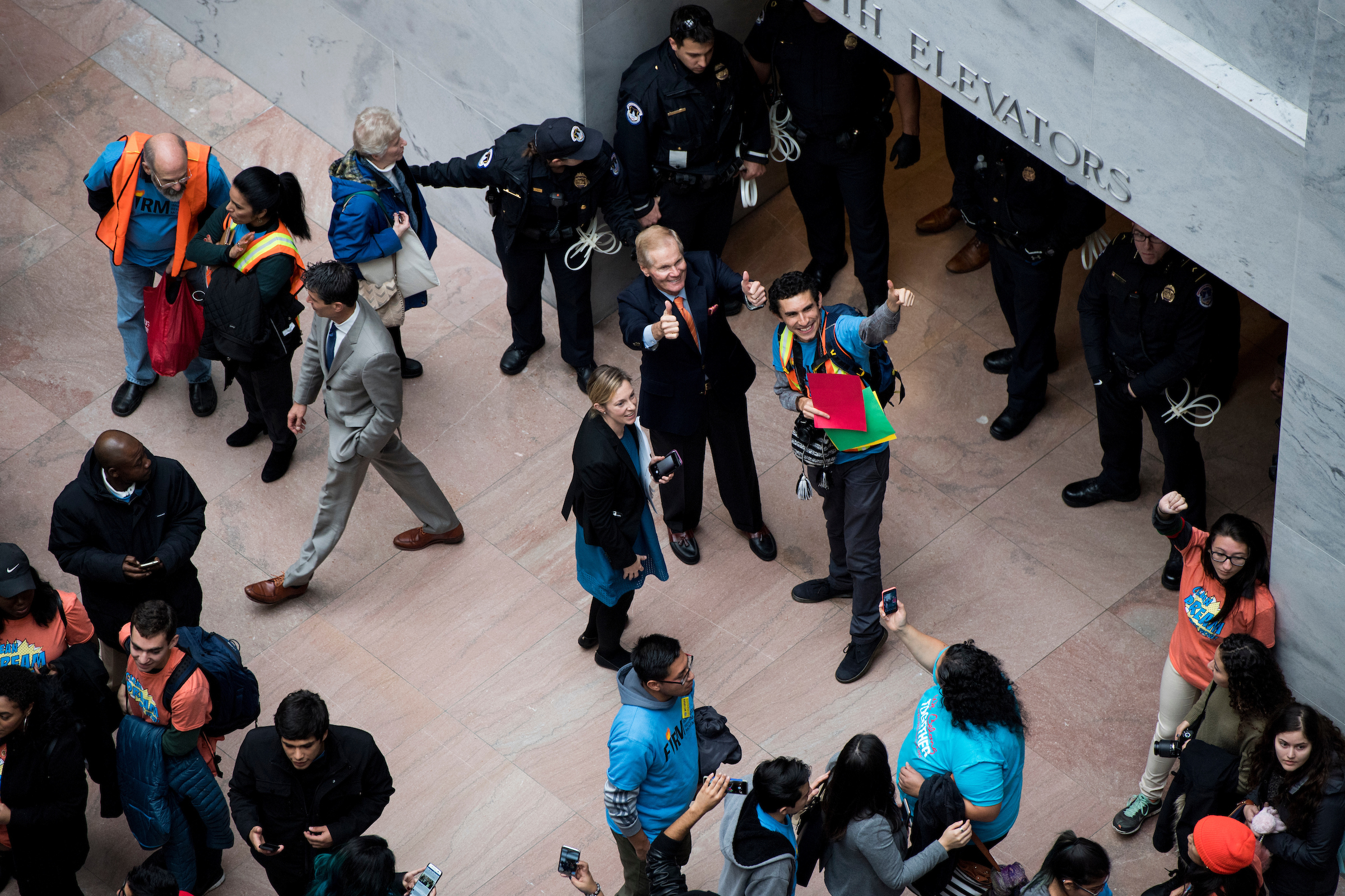 Sen. Bill Nelson, D-Fla., gives a thumbs up to protesters. (Bill Clark/CQ Roll Call)