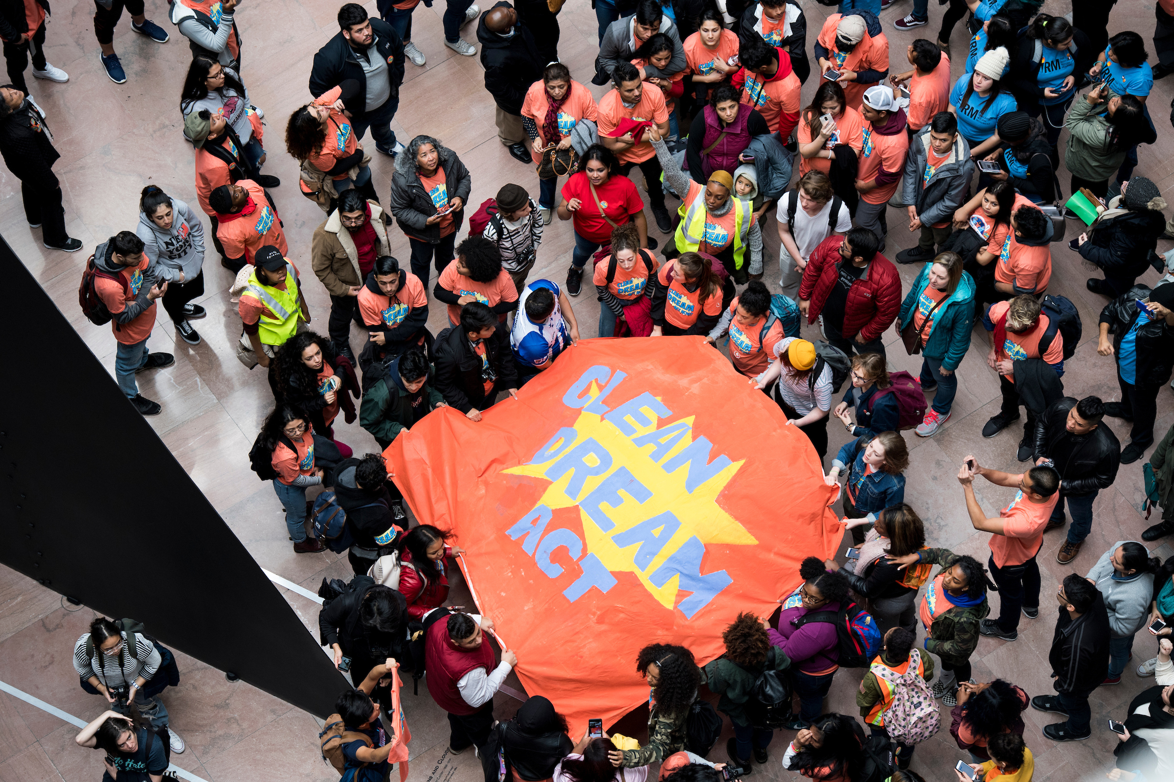 Protesters hold a banner demanding a clean Dream Act in the Hart Senate Office Building. (Bill Clark/CQ Roll Call)