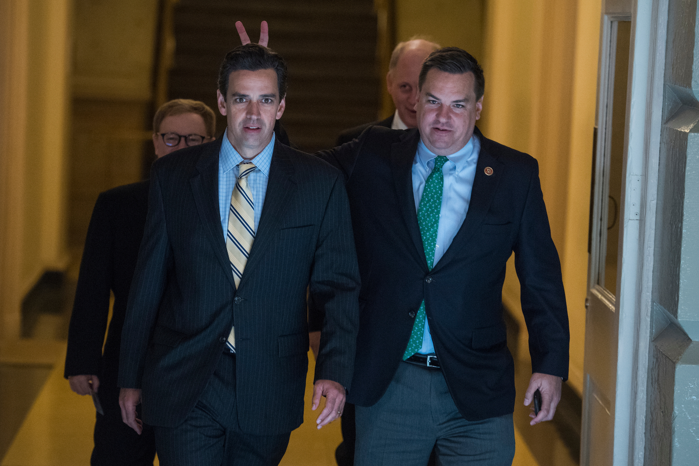 UNITED STATES - NOVEMBER 16: Rep. Richard Hudson, R-N.C., right, gives Rep. Tom Graves, R-Ga., bunny ears as they make their way to a meeting with President Donald Trump and House Republican Conference in the Capitol to discuss the GOP's tax reform bill on November 16, 2017. (Photo By Tom Williams/CQ Roll Call)