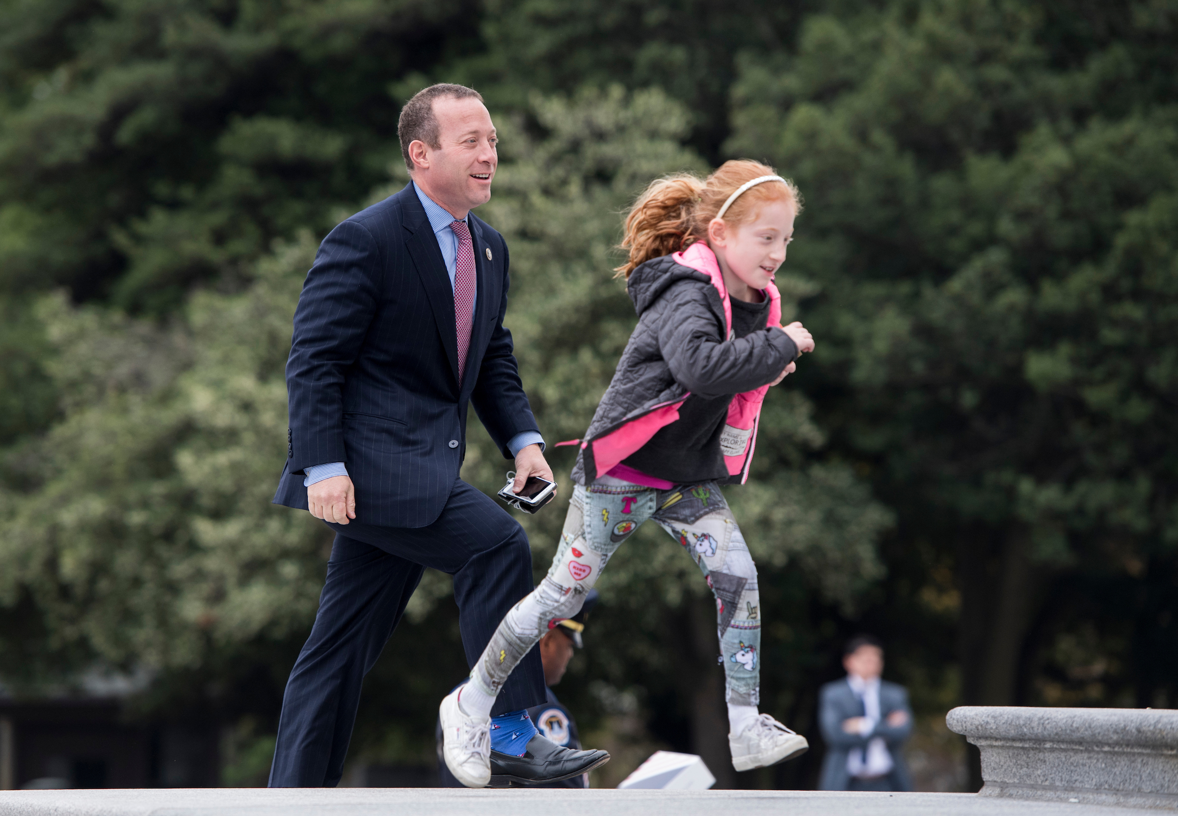 UNITED STATES - NOVEMBER 9: Rep. Josh Gottheimer, D-N.J., walks up the House steps with his daughter Ellie for a vote in the Capitol on Thursday, Nov. 9, 2017. (Photo By Bill Clark/CQ Roll Call)