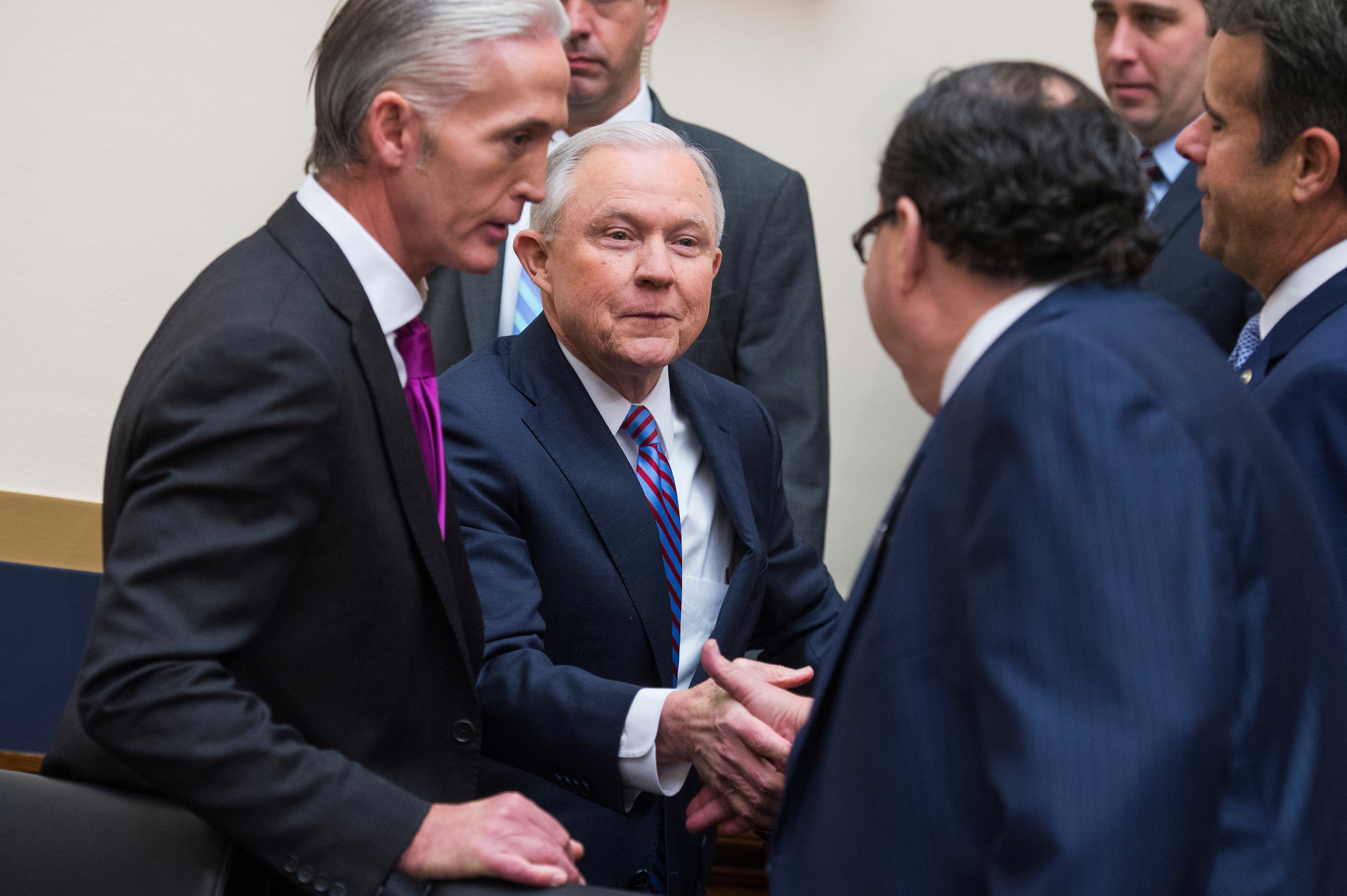 UNITED STATES - NOVEMBER 14: Attorney General Jeff Sessions greets Reps. Blake Farenthold, R-Texas, right, and Trey Gowdy, R-S.C., left, upon arriving to testify before a House Judiciary Committee hearing in Rayburn Building on November 14, 2017, on oversight of the Department of Justice where he fielded a variety of questions including immigration and Russian meddling in the 2016 election. (Photo By Tom Williams/CQ Roll Call)