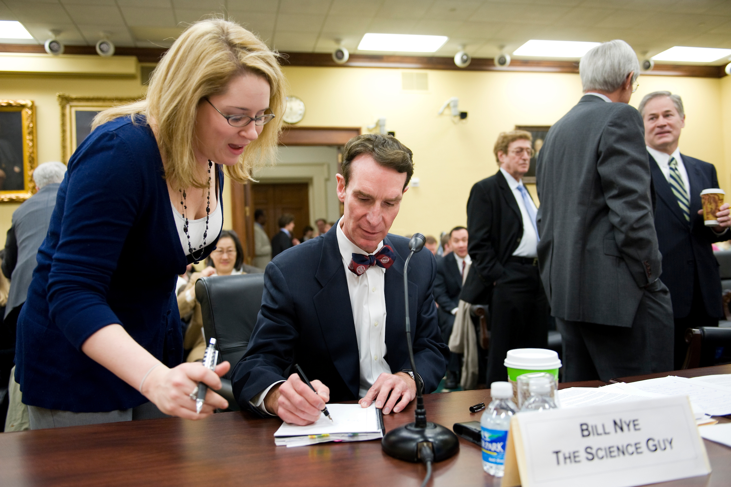 "Bill Nye ""The Science Guy,"" signs an autograph before the start of a House Appropriations subcommittee hearing on science education, March 5, 2009."