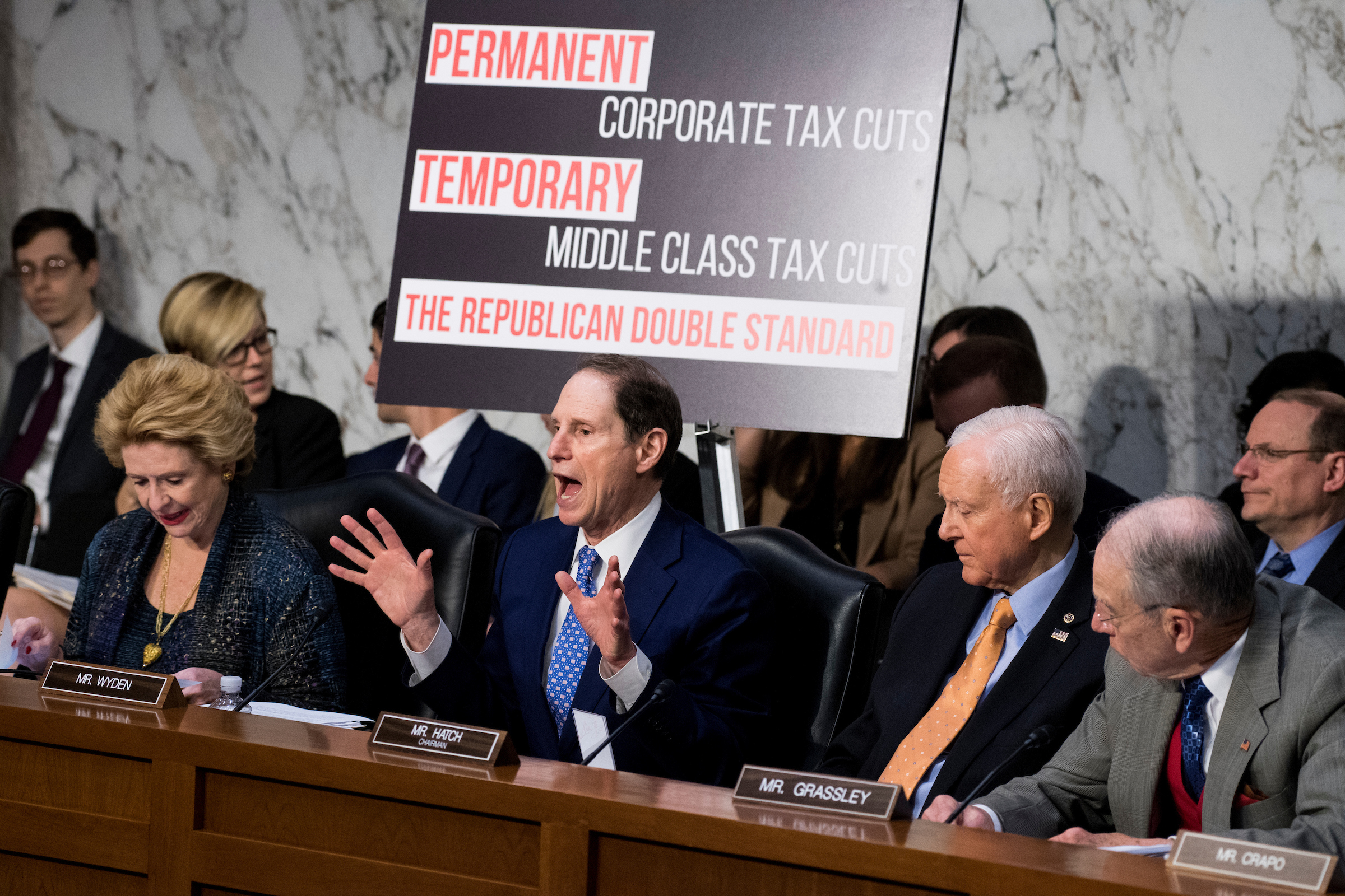 "From left, Sen. Debbie Stabenow, D-Mich., ranking member Sen. Ron Wyden, D-Ore., chairman Sen. Orrin Hatch, R-Utah, and Sen. Chuck Grassley, R-Iowa, participate in the Senate Finance Committee markup of the ""Tax Cuts and Jobs Act"" on Wednesday, Nov. 15, 2017. (Photo By Bill Clark/CQ Roll Call)"