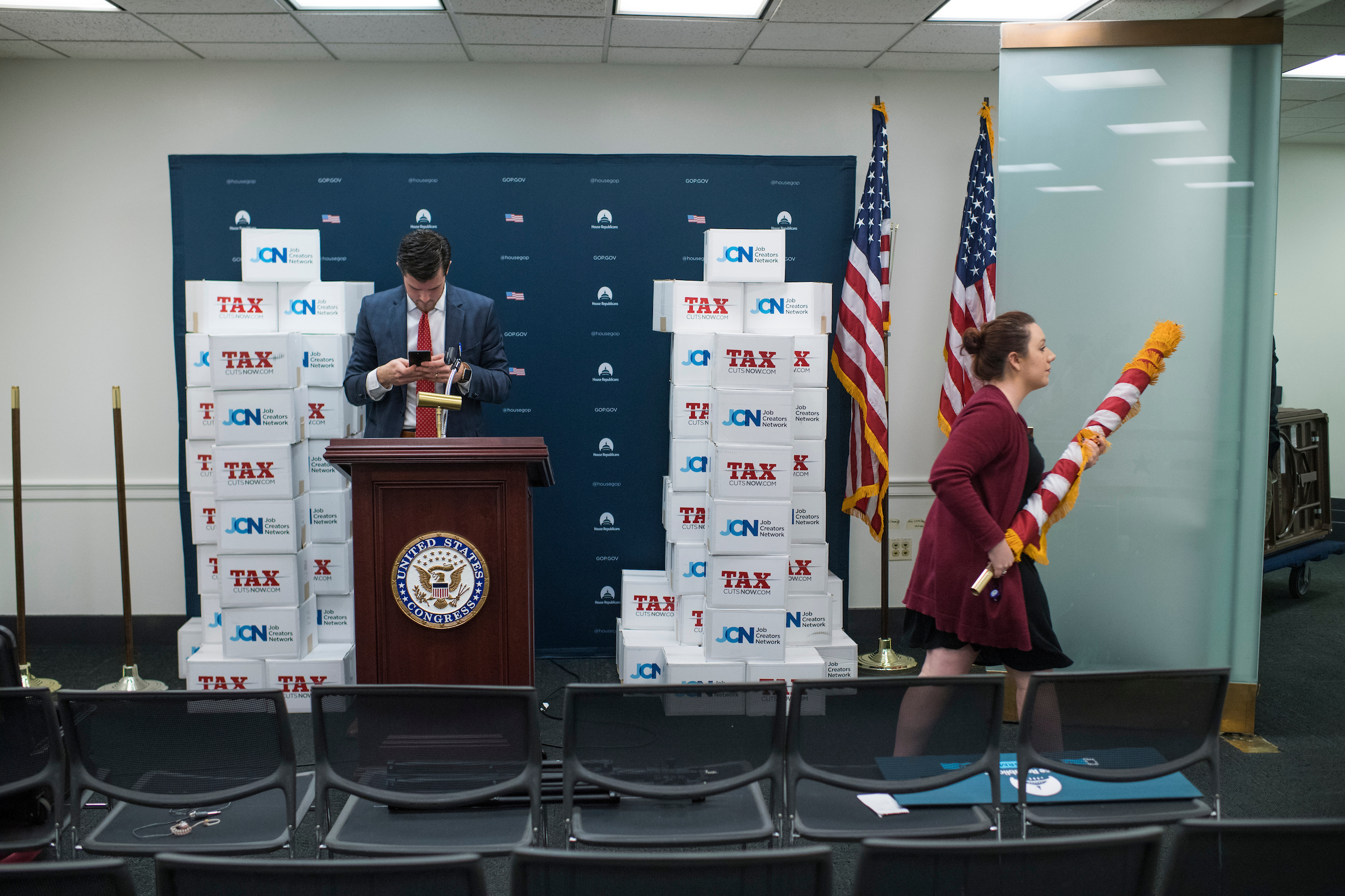 UNITED STATES - NOVEMBER 14: Aides break down a news conference conducted by Speaker Paul Ryan, R-Wis., and GOP leaders, featuring boxes of tax reform petitions after a meeting of the House Republican Conference in the Capitol on November 14, 2017. (Photo By Tom Williams/CQ Roll Call)
