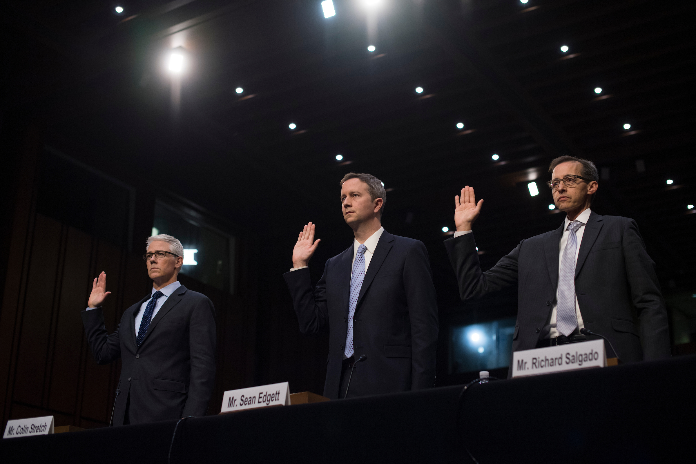"UNITED STATES - OCTOBER 31: From left, Colin Stretch, general counsel for Facebook, Sean Edgett, acting general counsel at Twitter, and Richard Salgado, director for information security and law enforcement matters at Google, are sworn into a Senate Judiciary Crime and Terrorism Subcommittee hearing in Hart Building titled ""Extremist Content and Russian Disinformation Online: Working with Tech to Find Solutions,"" on October 31, 2017. (Photo By Tom Williams/CQ Roll Call)"