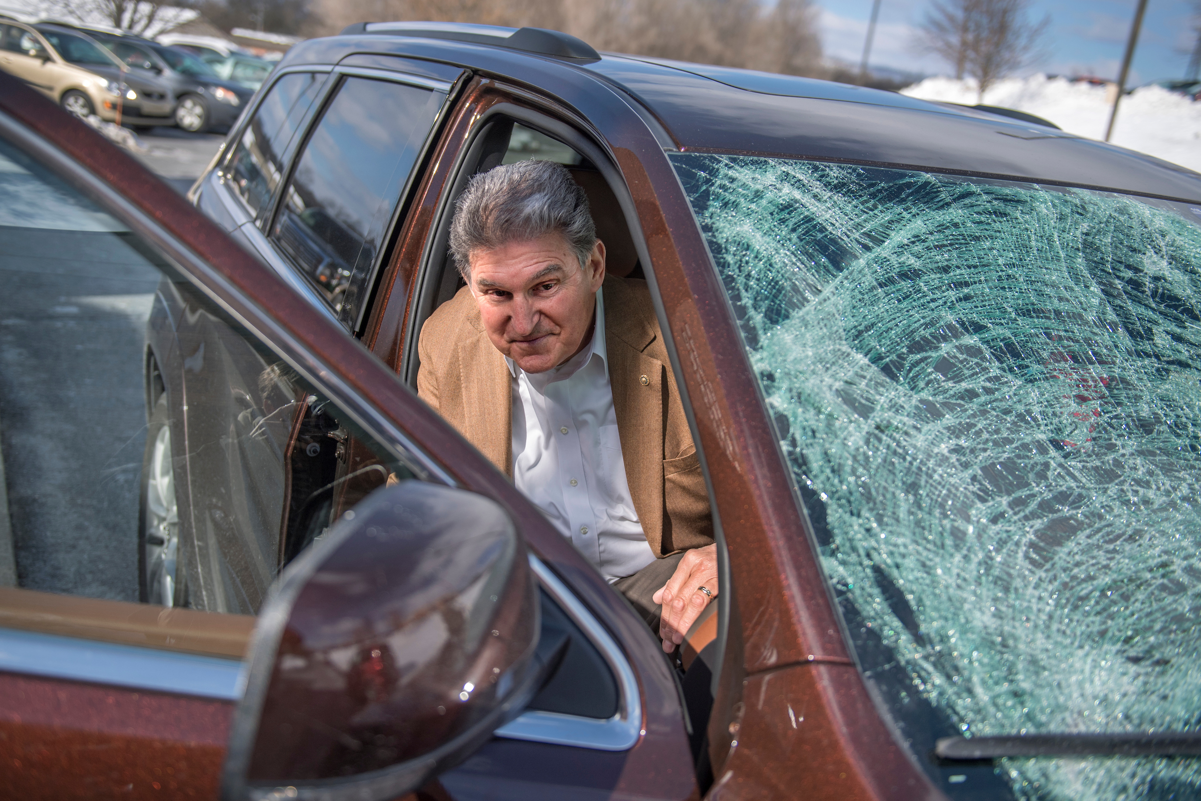 UNITED STATES - MARCH 16: Sen. Joe Manchin, D-W.Va., arrives for town hall meeting at the WVU Robert C. Byrd Health Sciences Center in Martinsburg, W.Va., after his windshield was shattered by a piece of ice,March 16, 2017. Much the discussion was regarding the American Health Care Act, the Republican's plan to repeal and replace the ACA. (Photo By Tom Williams/CQ Roll Call)