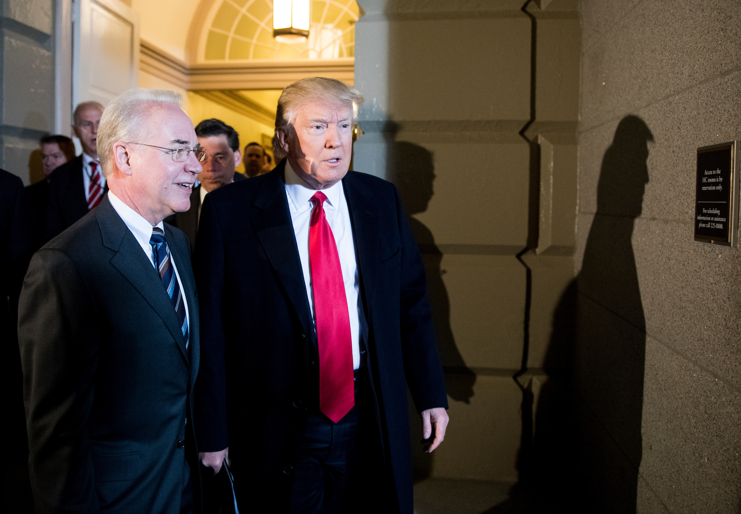 UNITED STATES - MARCH 21: President Donald Trump and Secretary of Health and Human Services Tom Price arrive in the Capitol to meet with the House Republican Conference on Tuesday, March 21, 2017. (Photo By Bill Clark/CQ Roll Call)