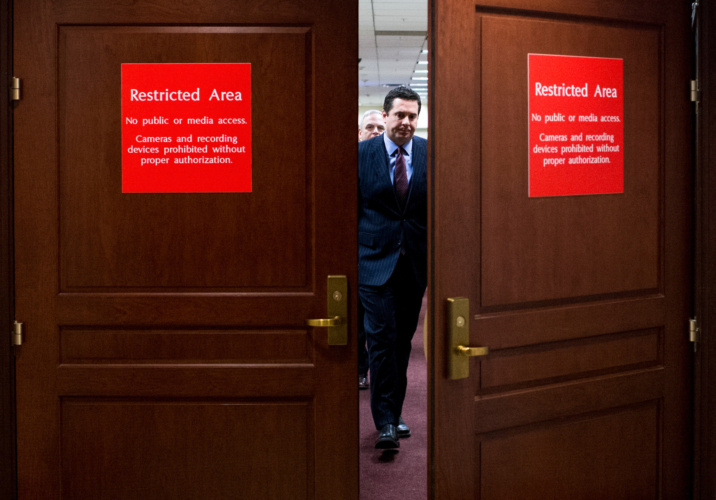 UNITED STATES - MARCH 22: House Intelligence Committee Chairman Rep. Devin Nunes, R-Calif., makes his way from the committee's offices to the microphones to hold a news conference in the Capitol on Wednesday, March 22, 2017. (Photo By Bill Clark/CQ Roll Call)