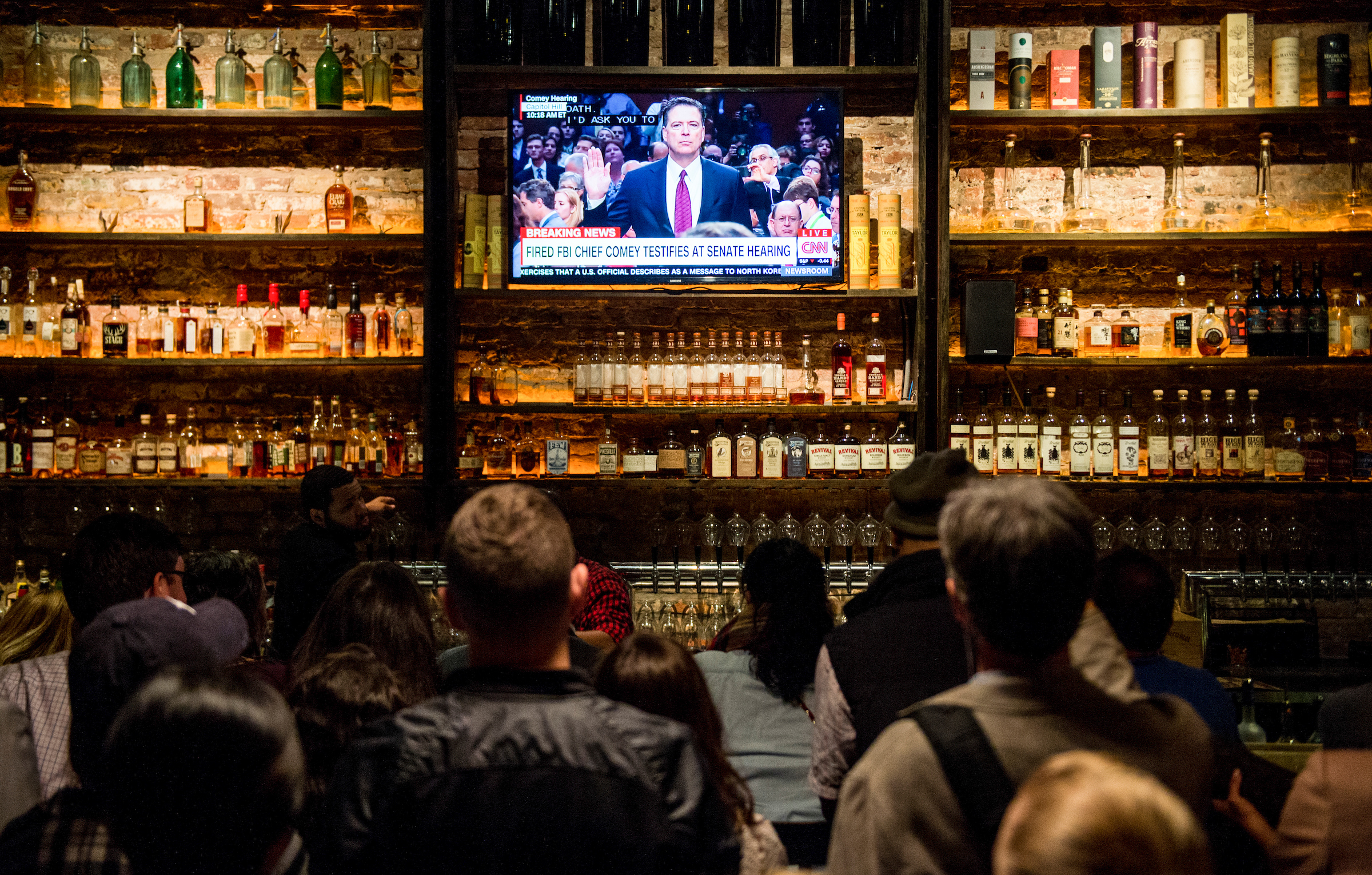 UNITED STATES - JUNE 8: The crowd gathered at The Partisan bar Comey watch party in Washington watch as former FBI Director James Comey arrives to testify during the Senate Select Intelligence Committee hearing on Thursday, June 8, 2017. (Photo By Bill Clark/CQ Roll Call)