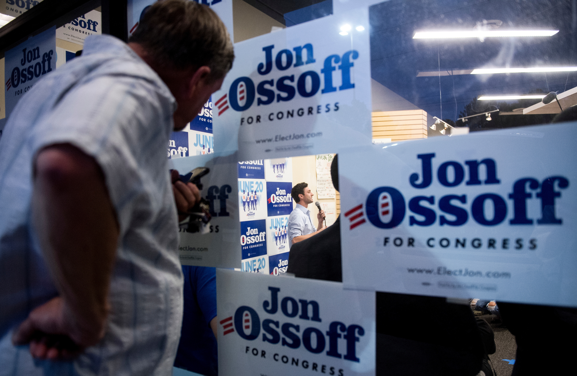 UNITED STATES - JUNE 19: Supporters watch from outside the packed final campaign rally for Democratic candidate for Georgia's 6th Congressional district Jon Ossoff at his campaign office in Roswell, Ga., on the final day of campaigning on Monday, June 19, 2017. Ossoff is facing off against Republican Karen Handel in the special election to fill the seat vacated by current HHS Secretary Tom Price will be held on Tuesday. (Photo By Bill Clark/CQ Roll Call)