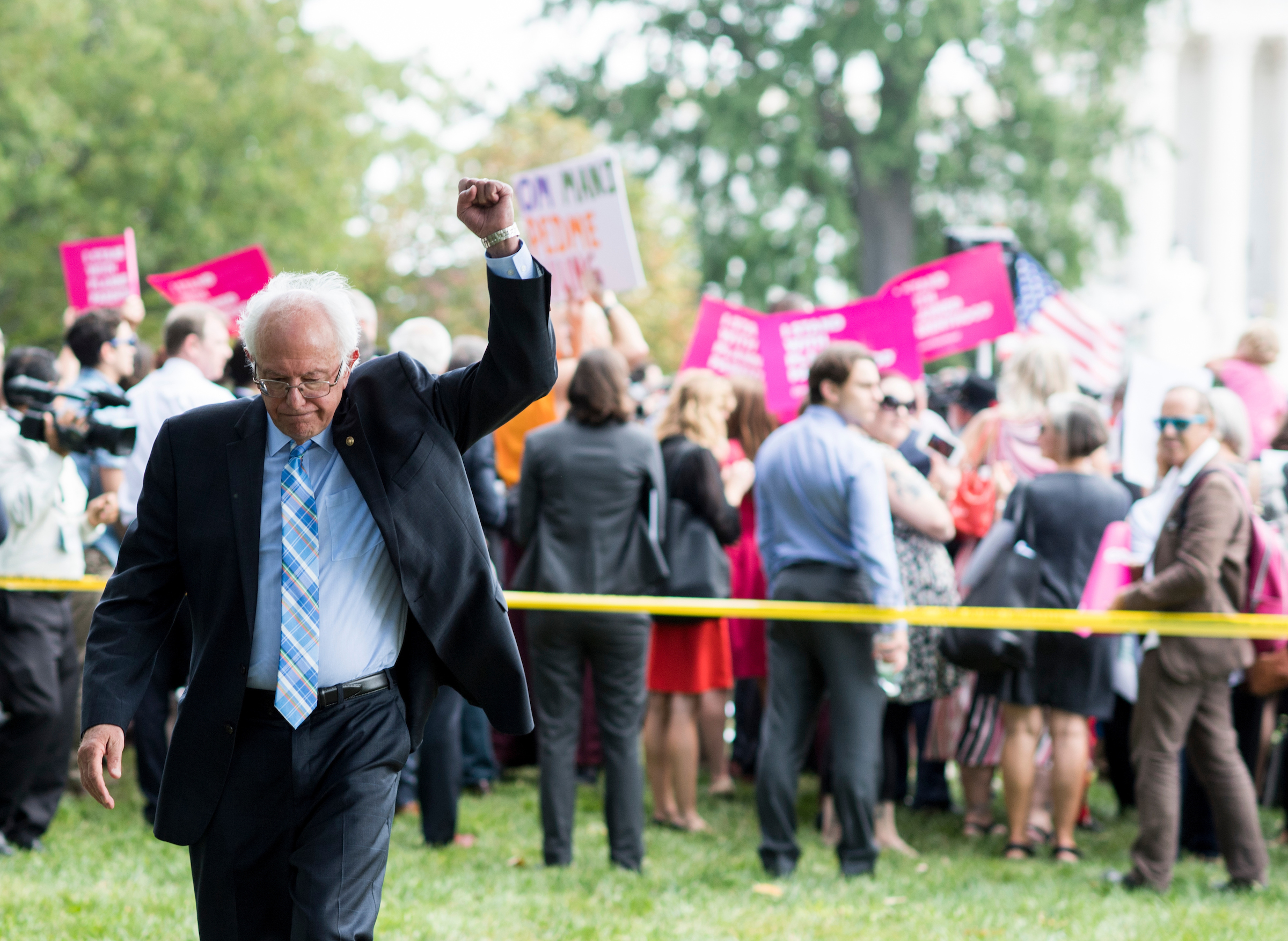 "UNITED STATES - SEPTEMBER 19: Sen. Bernie Sanders, I-Vt., raises his fist as rally attendees chant ""Bernie"" following his speech to the rally at the Capitol on Tuesday, Sept. 19, 2017. Senate Democrats held the rally to oppose the Senate Republicans's effort to repeal the Affordable Care Act with the Graham-Cassidy proposal. (Photo By Bill Clark/CQ Roll Call)"